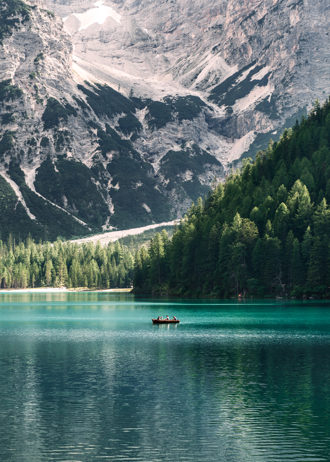 summer row boat on Pragser Wildsee in Italy. Kirsty Owen photography