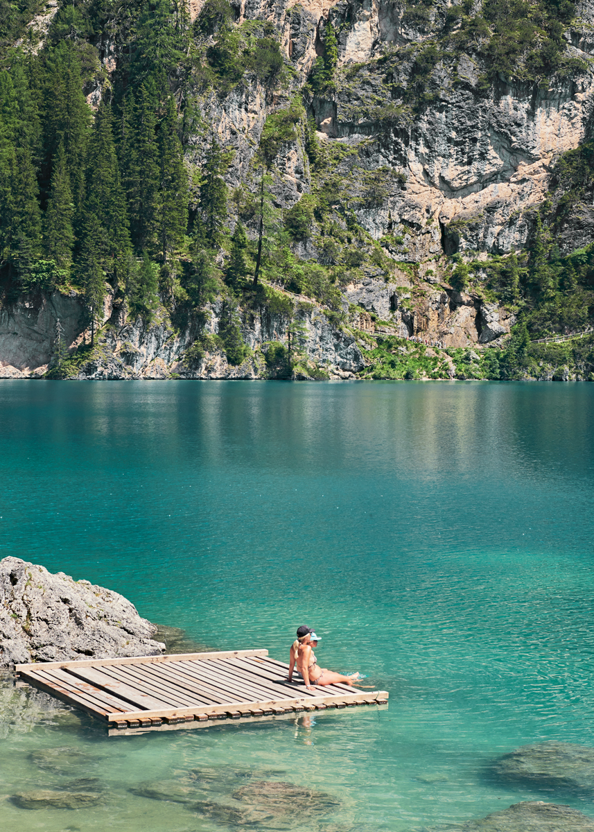 Sunbathers at Pragser Wildsee, Lago di Braies in Italy. Kirsty Owen photography