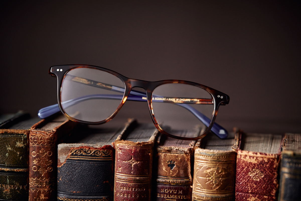 mens glasses on library books Kirsty Owen photography
