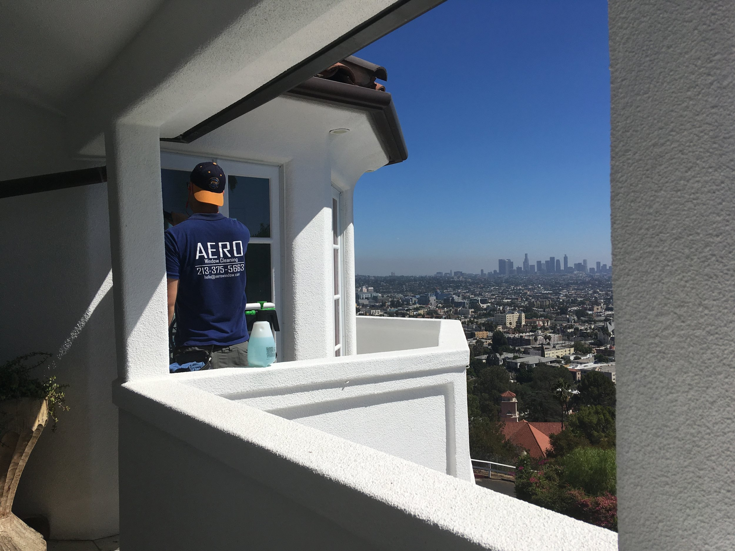 Tom washing windows in Los Feliz