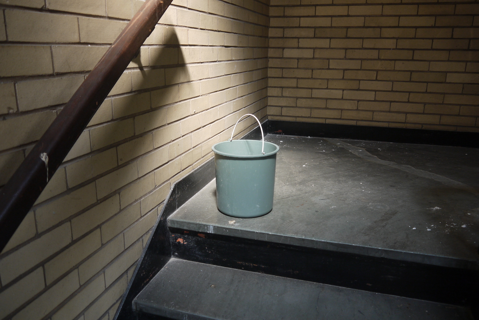 The bucket seems extra heavy and special here on the 7th floor landing.