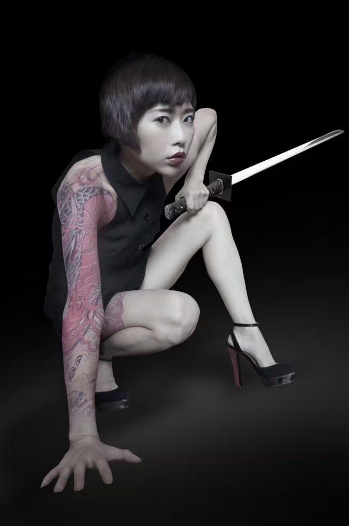 Tan Yuanwu. Tattoos and swords edited in by her husband. Photo credit: Tan Yuanwu.