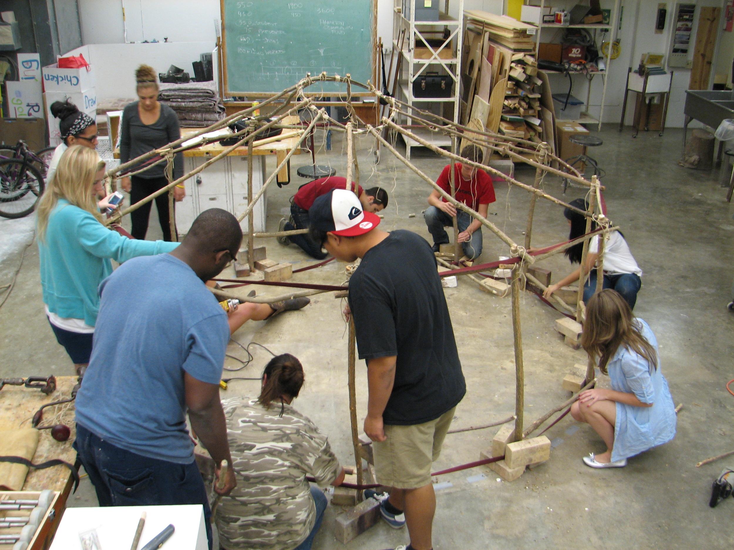 Students building yurt in the Miami Sculpture studio