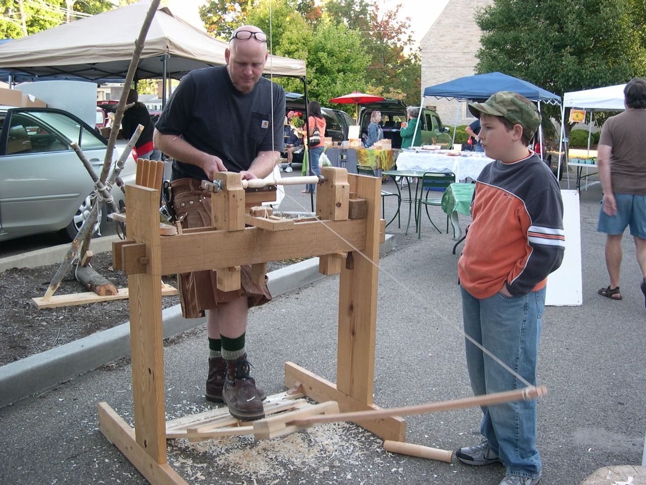 Demonstrating the spring-pole lathe to Eli