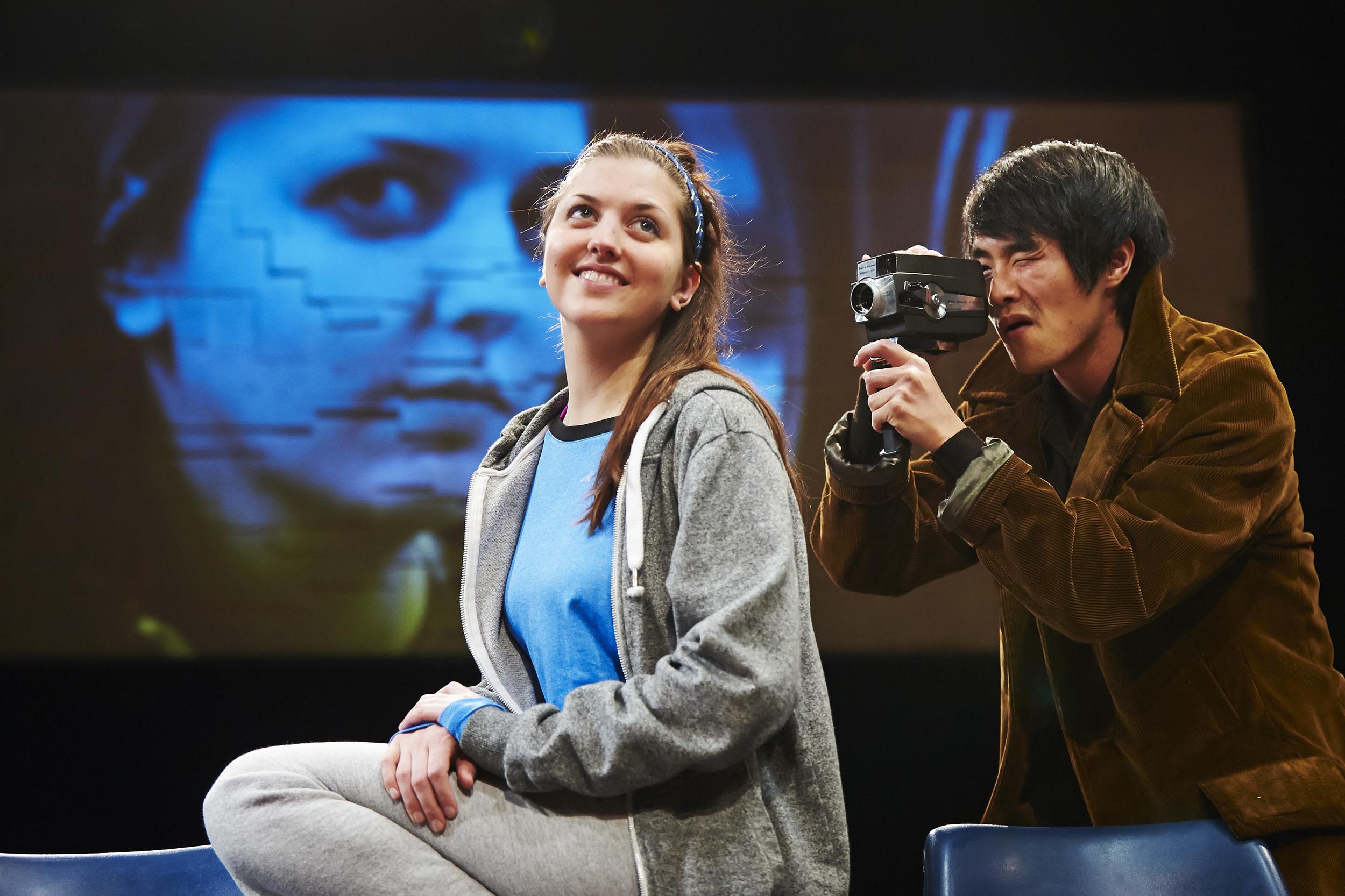 Oblivion Website - Julie, Bernard filming vid in background.jpg