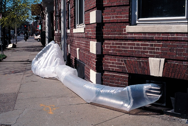 """George L.'s  para SITE shelter. Made on a budget of $5.00 from trash bags, ZipLoc bags, and clear waterproof packing tape. George requested a system of """"ribs"""" that would be made of semi-translucent trash bags. In between the ribs, he wanted windows to expose the """"meat"""" between the bones."""