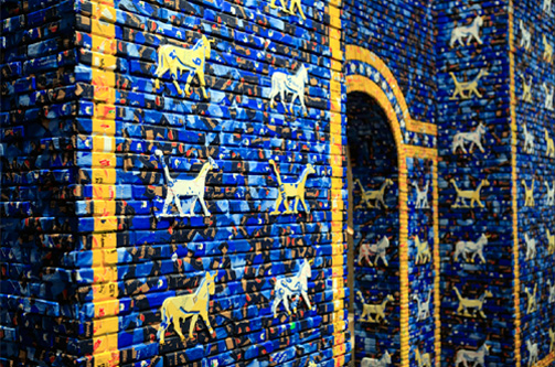 Installed in the entrance of the exhibition space at the Haus Der Kulturen Der Welt,  May   the     Arrogant   Not   Prevail  is a scaled-down reconstruction of the reconstruction of the Ishtar Gate still standing in Iraq. Built by a Berlin-based team of assistants out of plywood and wooden beams, and clad with color-correct packaging of Arabic foodstuffs found in Berlin, the gate extends many of the material themes and conceptual concerns of  The     invisible     enemy     should   not   exist , but, just like the title, serves as an alternate translation.