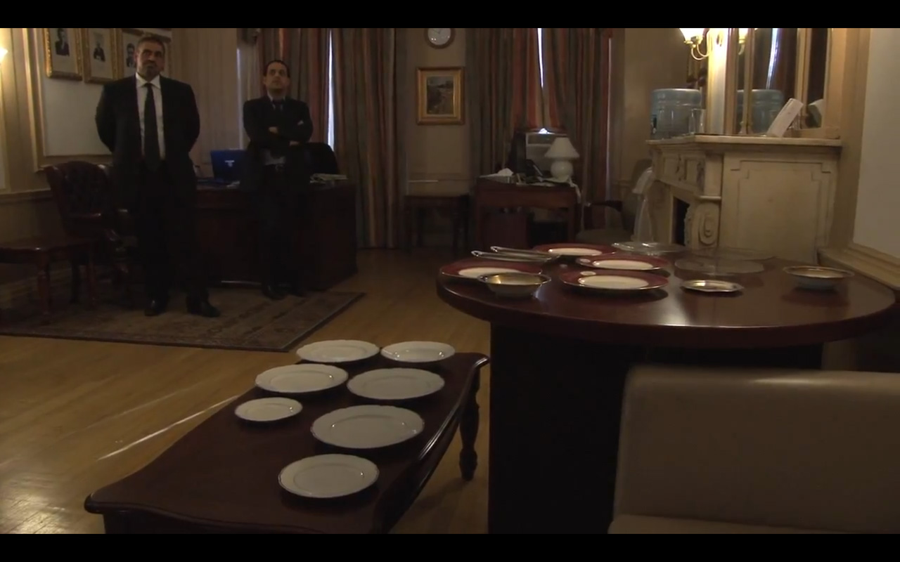 Video still of Saddam Hussein's dishes being repatriated to the Republic of Iraq at the request of Iraqi Prime Minister Nouri al-Maliki and at the behest of US President Barack Obama during their meeting in Washington, D.C. on December 11, 2011 to finalize plans for American withdrawal from Iraq and transfer of sovereignty to take effect four days later. The plates traveled back to Baghdad on the same flight as the Iraqi Prime Minister. They will go on display in Saddam's palaces, which will be transformed into museums. Reports on the project's conclusion accompanied reports on the end of the Iraq War by various news outlets, including The New York Times, The Rachel Maddow Show.