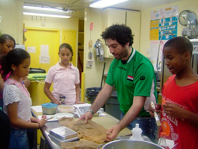 Making baklawa. Other dishes made with these students include kubba bamia, a meat dumpling stew served with okra over basmati rice.
