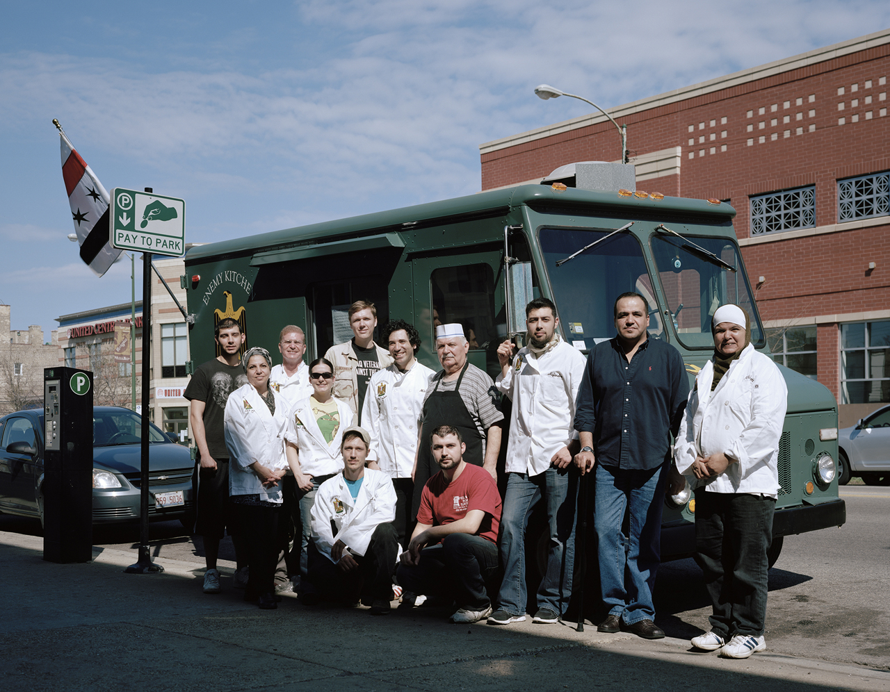 Enemy Kitchen staff, comprised of Iraqi refugees and American veterans of the Iraq War, outside of Milo's Pita Place, an Iraqi restaurant in Chicago's Rogers Park neighborhood that operates the truck. Most Iraqi restaurants in the city call themselves Middle Eastern or Mediterranean to protect themselves from jingoistic attacks. Enemy Kitchen is the city's first Iraqi restaurant to publicly declare itself as such.