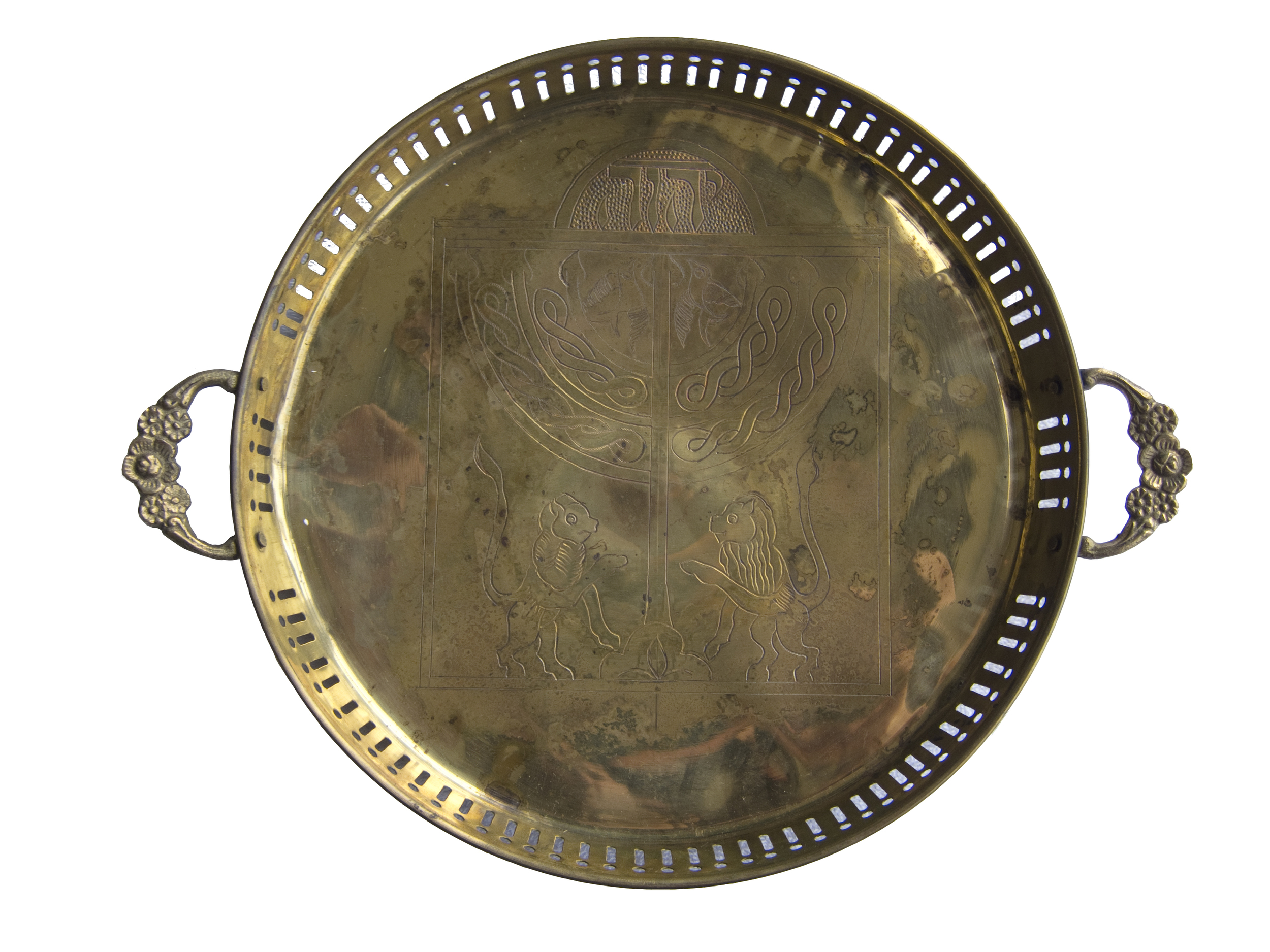 The surfaces upon which the dinners were served are from Jewish families who left Iraq in the 1940s and 1950s. Some are everyday dishes. Others are more precious, like the tray pictured here, which was used to serve traditional recipes in the Great Synagogue of Baghdad. Nearly all of the serving ware are small and made of metal, compact enough to be placed under clothing and smuggled—many Jews had to leave Iraq without any of their belongings— and sturdy enough to survive the journey without shattering.
