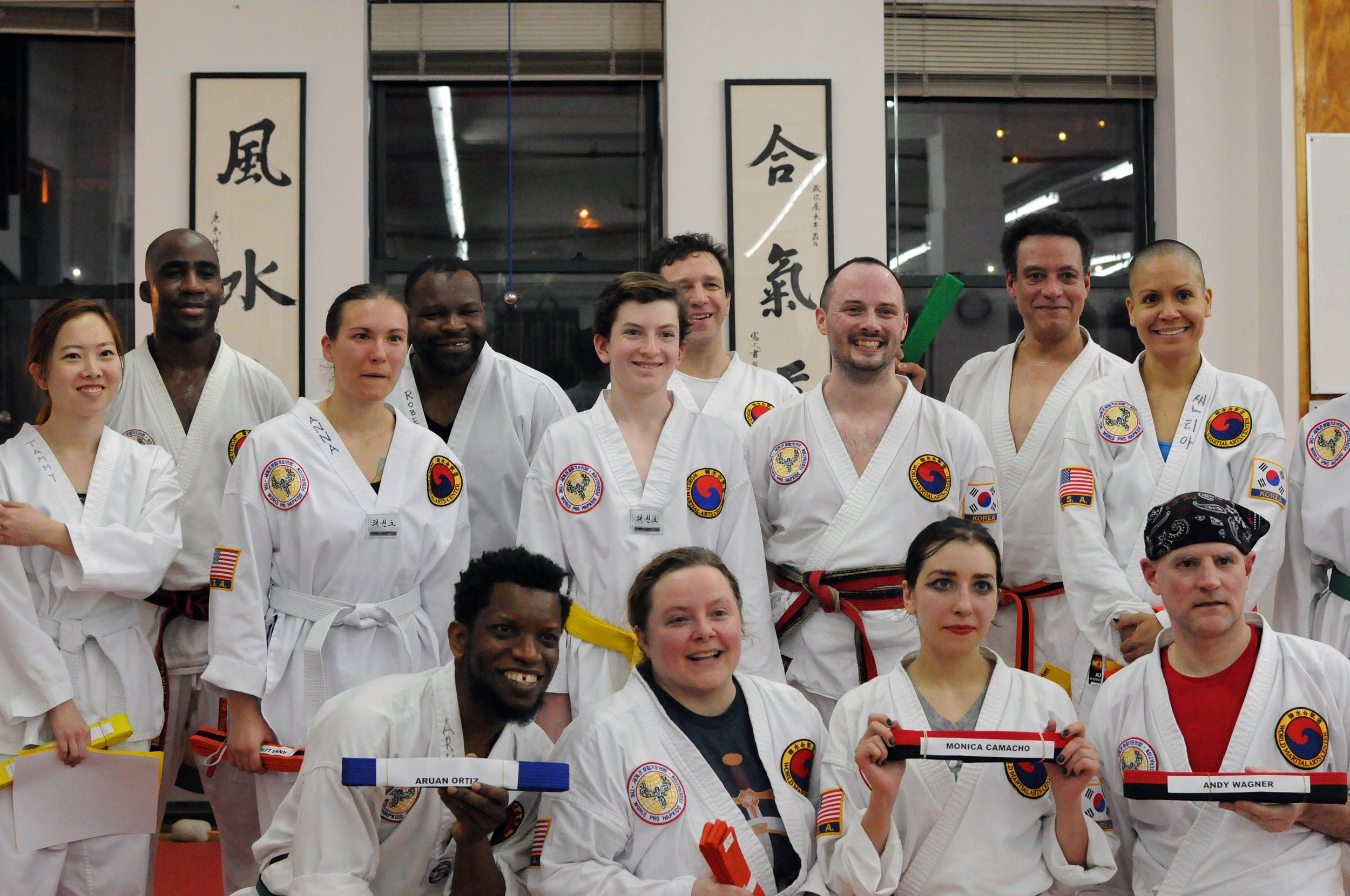 test participants show off their new belts.JPG