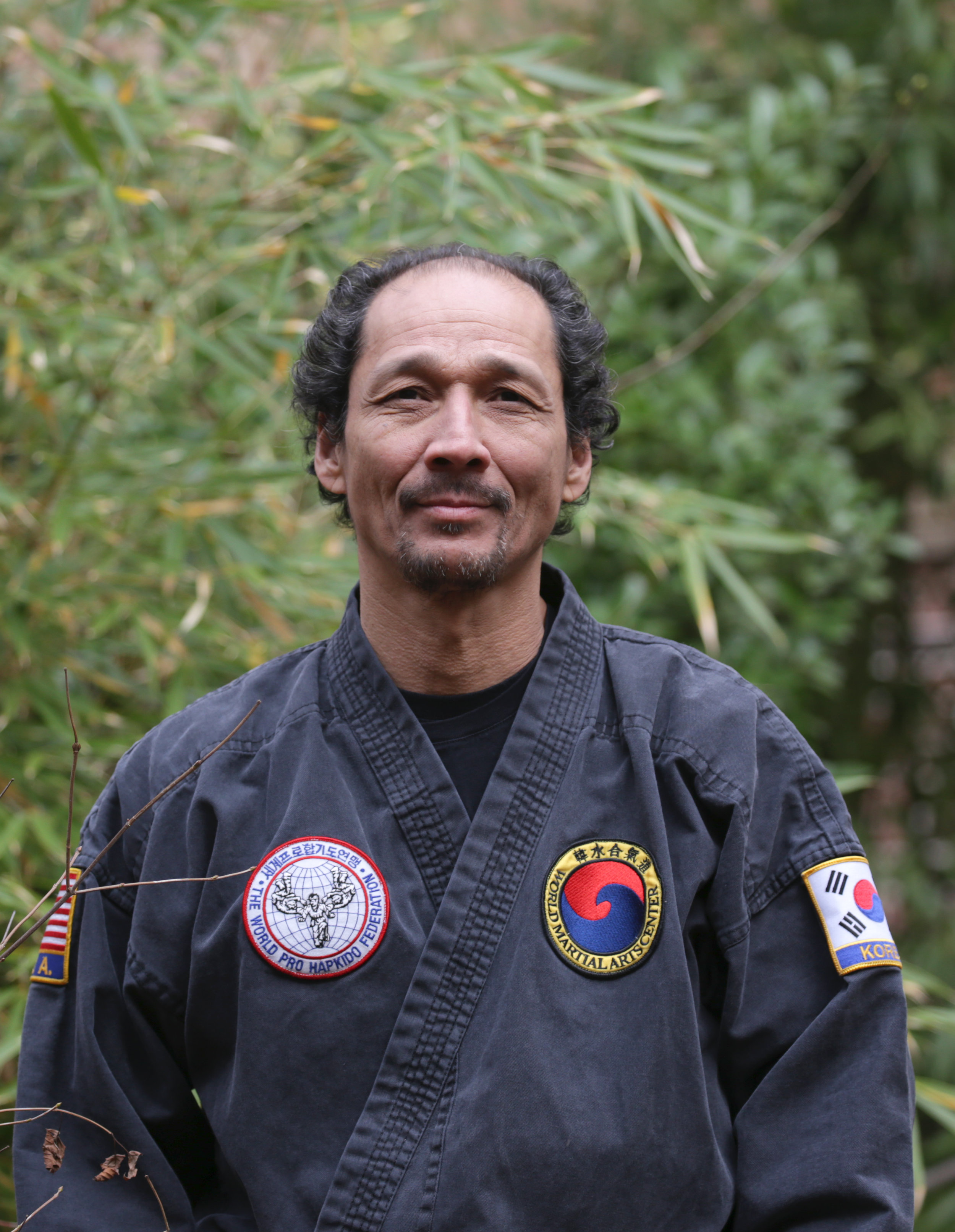 Certified Instructor  Marc Hungerbuhler has studied Martial Arts since early childhood. Born and raised in Switzerland to a Korean mother and Swiss father, his early practice was contextual. Max Hungerbuhler his father was the president of the Swiss Budo federation in 1955, and a 5th dan in Judo, the position was handed over from his grandmaster Hanho Rhi who founded the Swiss Jiu-Jitsu and Judo federation in 1937.  Growing up, Marc was trained in Judo by his father and his students who continued the dojang as principle instructors until the late 80s. Twenty-five years later,  enrolling his own children in the Hapkido School of Sabumnim Master Herbert, Marc reentered Martial Arts training in New York and has studied at WMAC since 2005.