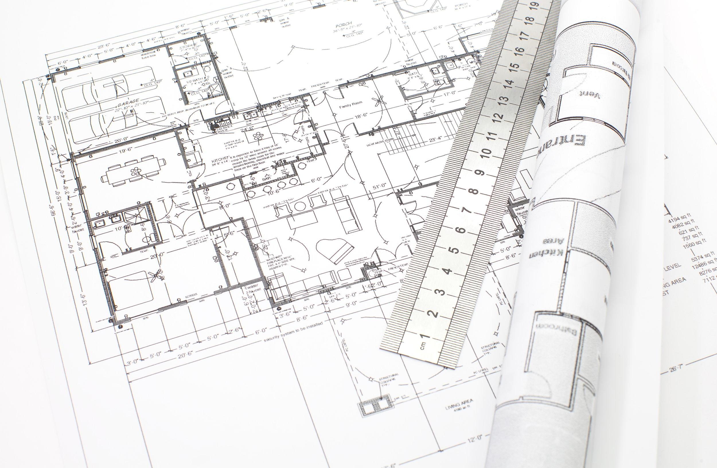 bigstock-Architecture-plan-and-rolls-of-53200192.jpg