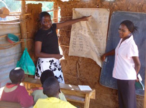 Interns Ann and Neema teach a literacy course at Lobarishareki Primary School.