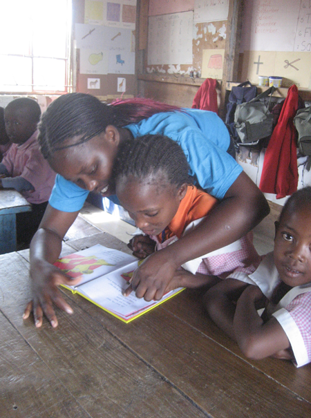 Sanaipei working with her second grade students during her internship in Lobarishereki Primary School in Sabuk, northern Kenya. 2009.