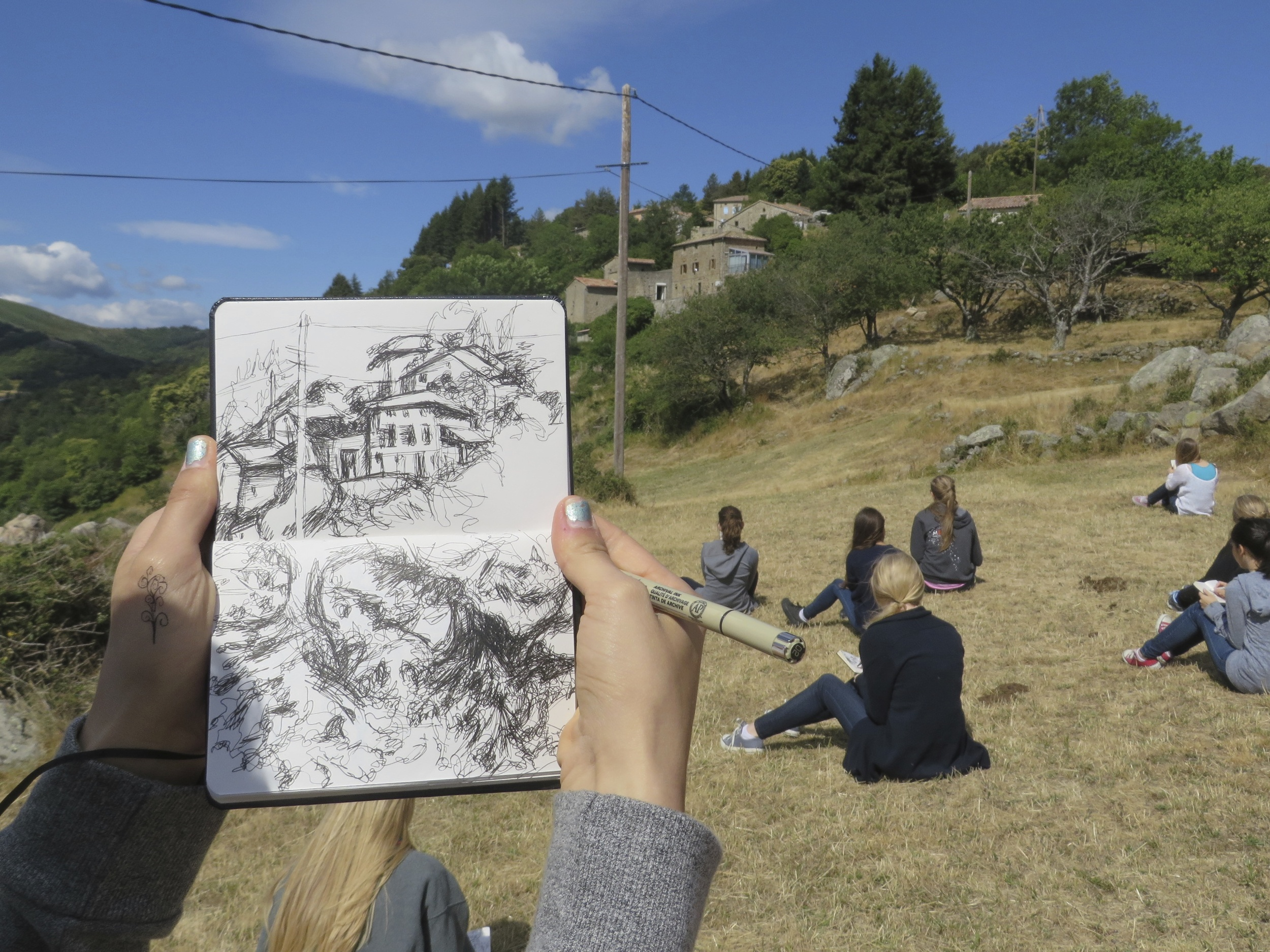 students drawing in sketchbooks in les tapies drawing and painting courses