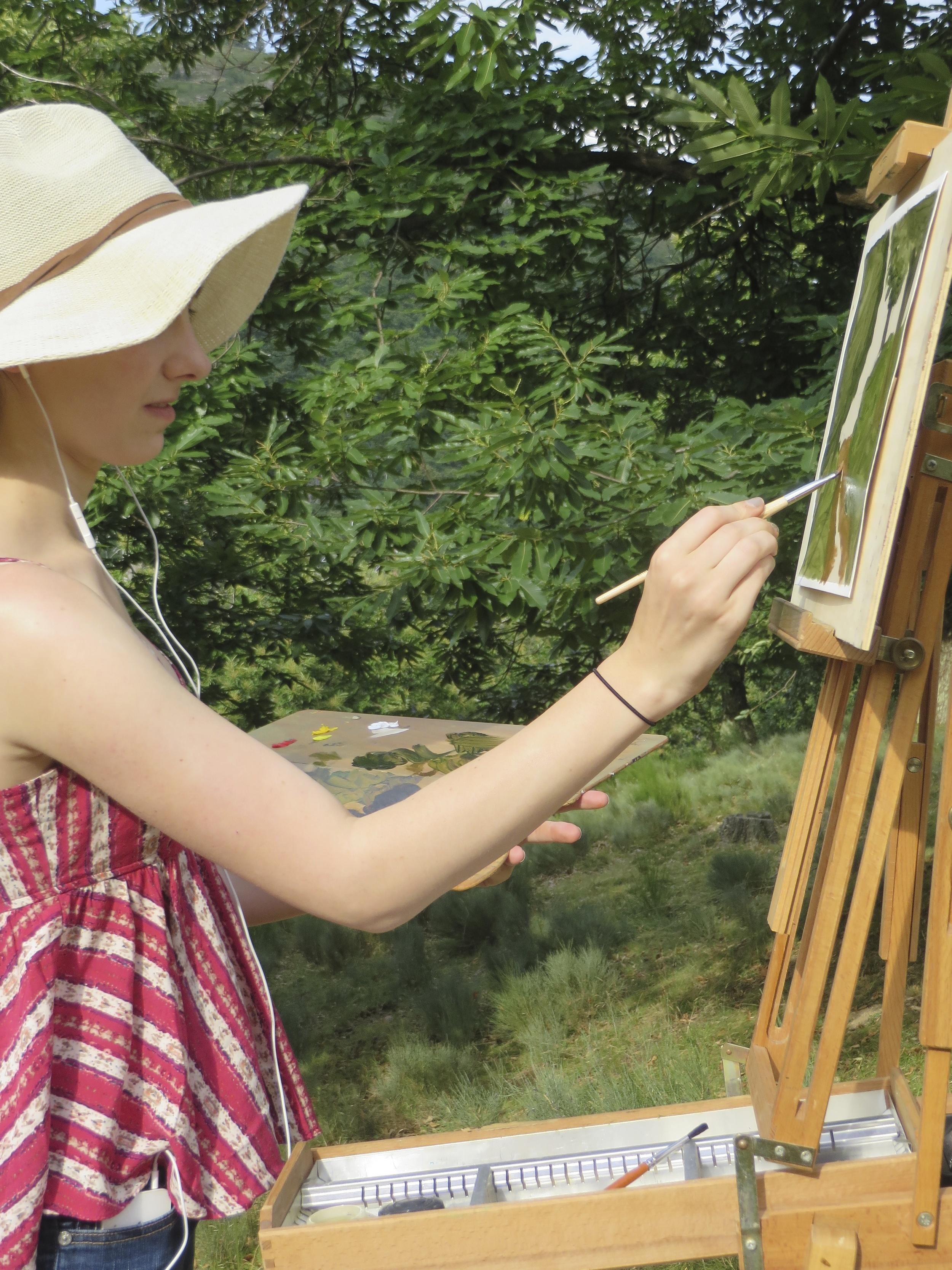 a student painting en plein air