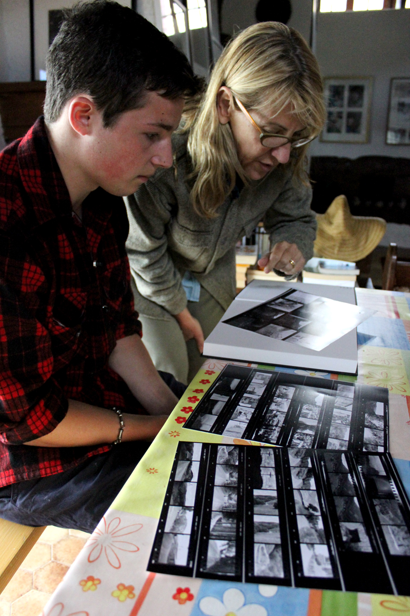 A student reviewing his contact sheets