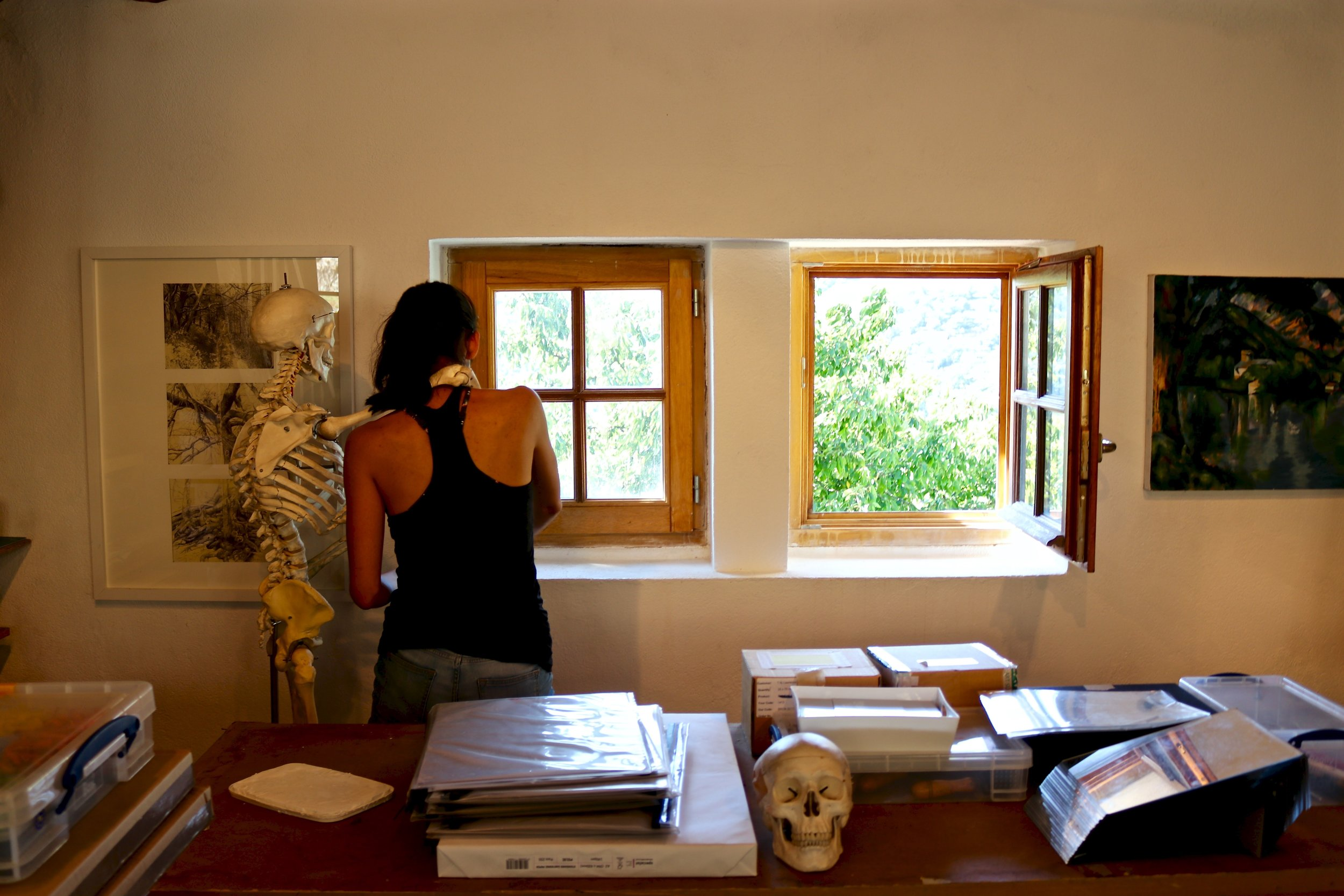 Some touch-ups to the walls have been added to lighten the rooms up. Here's Camila getting a helping hand from our resident skeleton.