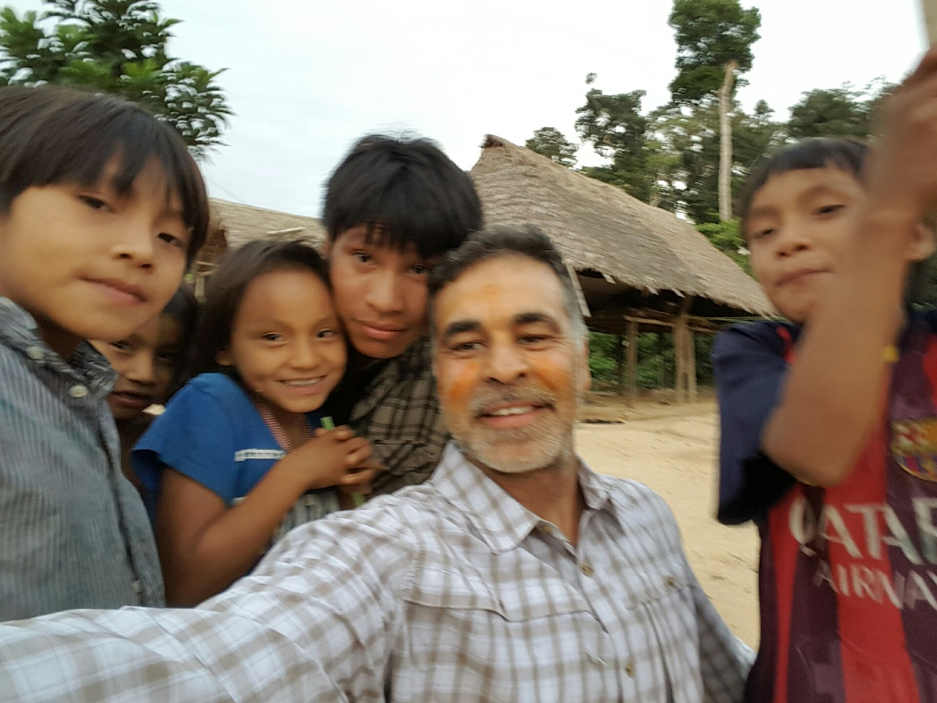 Mas enjoys his time with the native children.