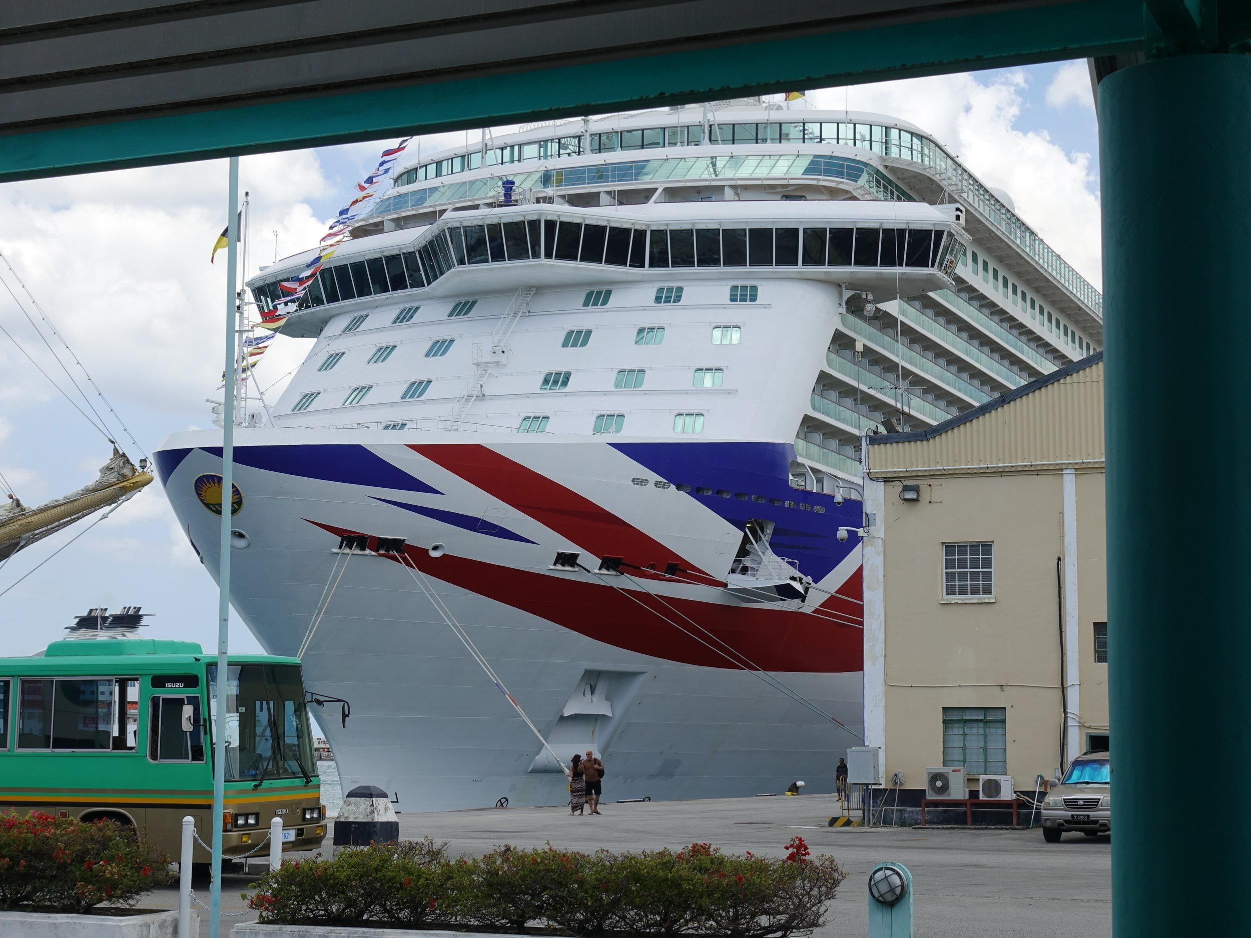 P&O Britannia dwarfing the port buildings in Barbados.