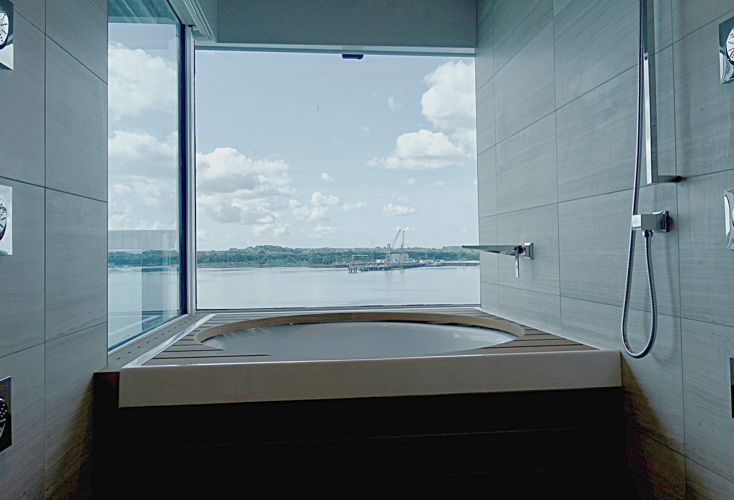 The amazing circular bath and multi-directional shower area set with a glass enclave in the Club Spa Suites.