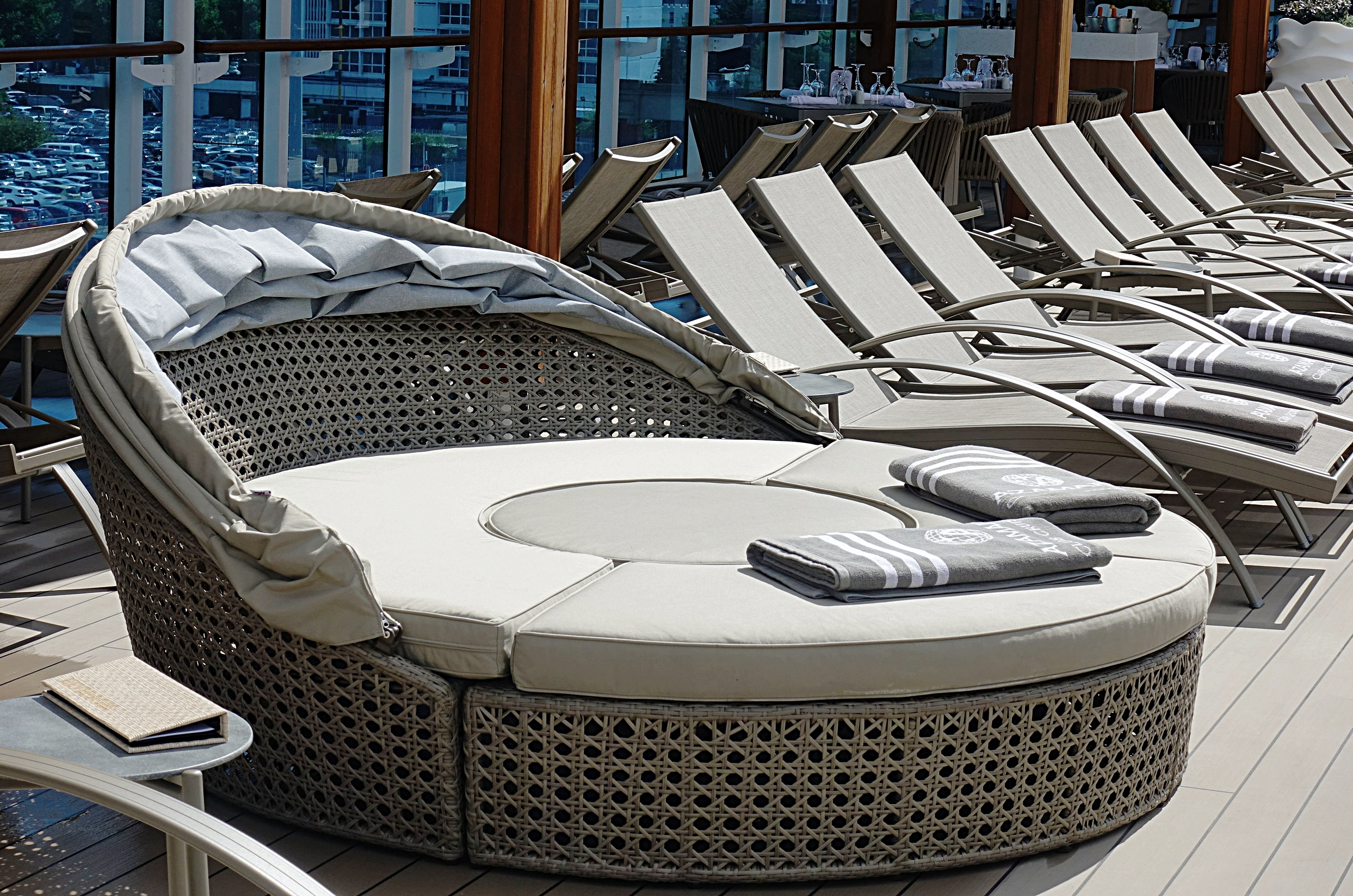 Daybeds on the pool deck.