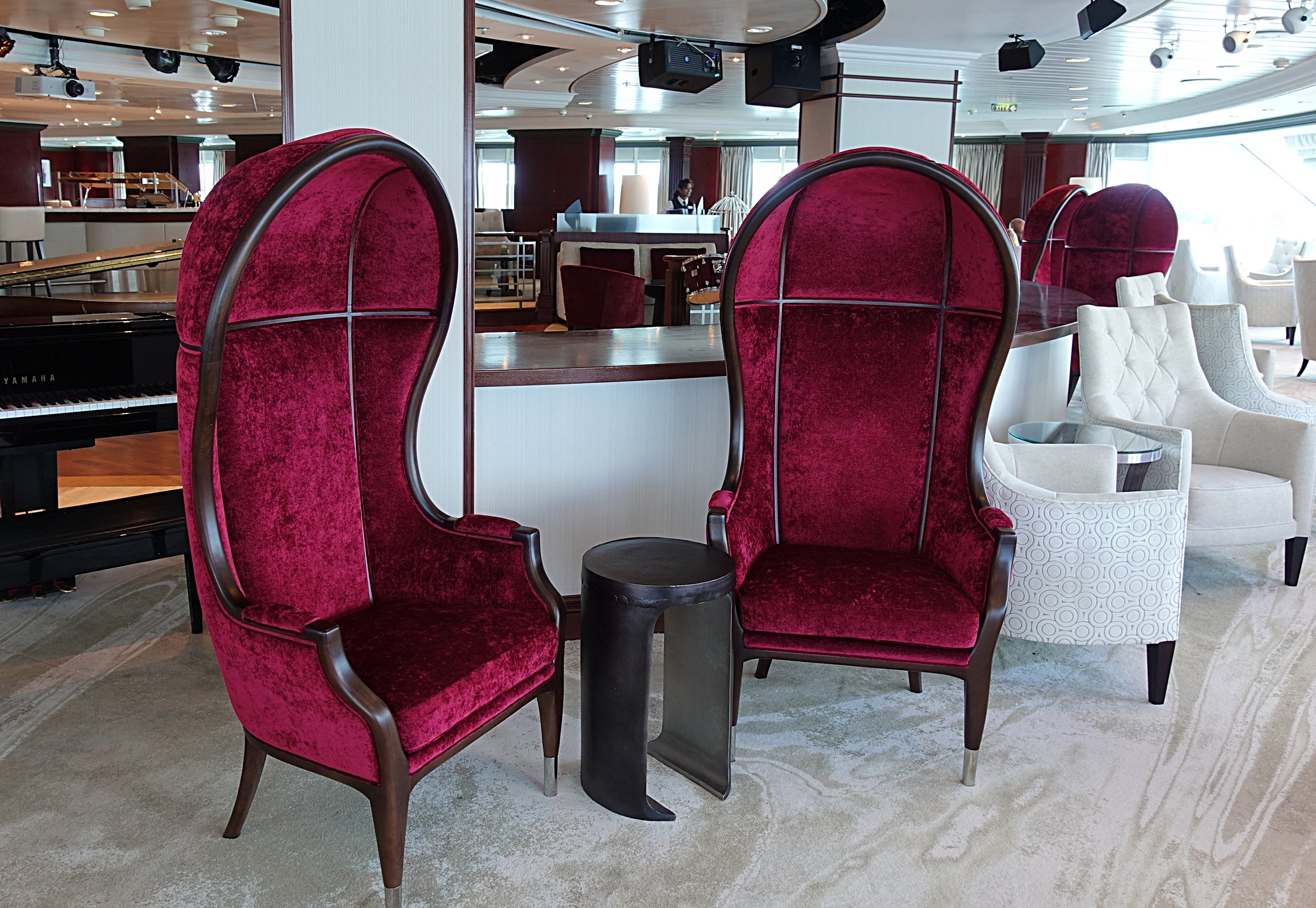 The light decor is offset by the deep tones of these quirky chairs.