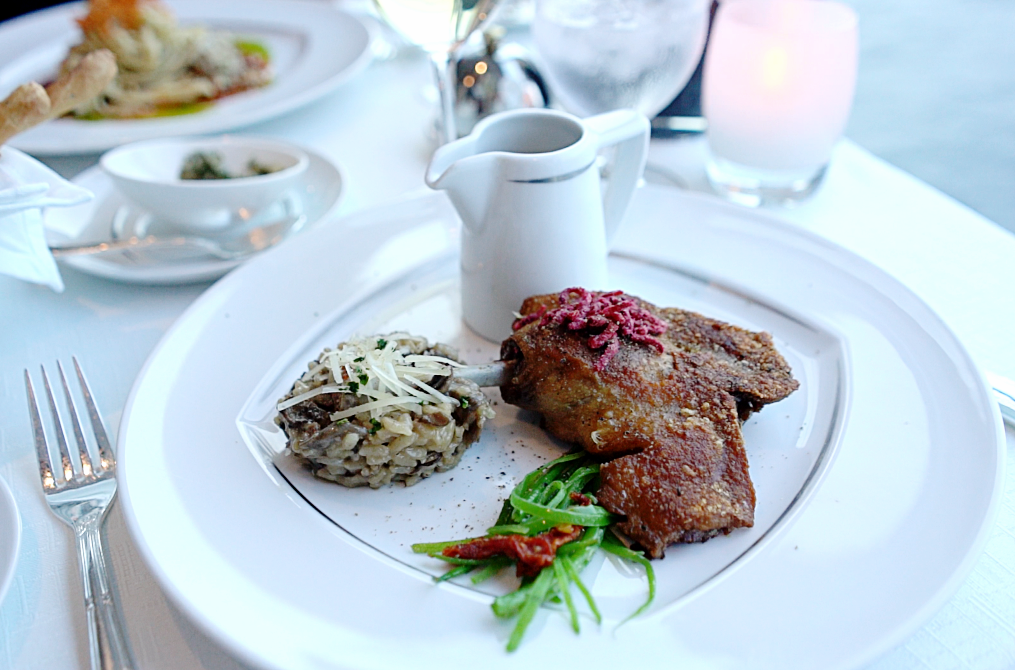 The mushroom risotto and duck leg confit in the Aqualina restaurant.