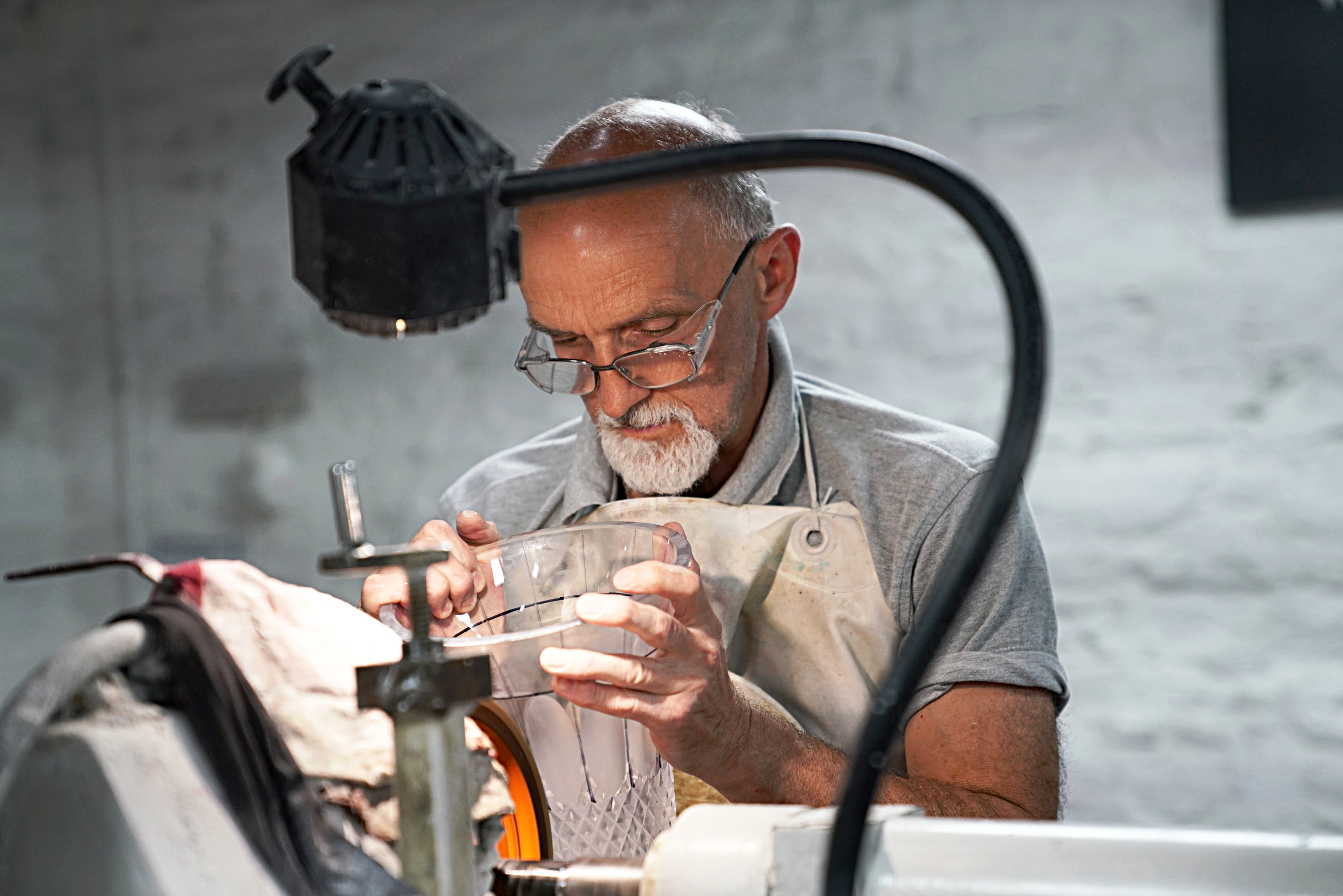 A master craftsman at work in the Waterford Crystal factory.