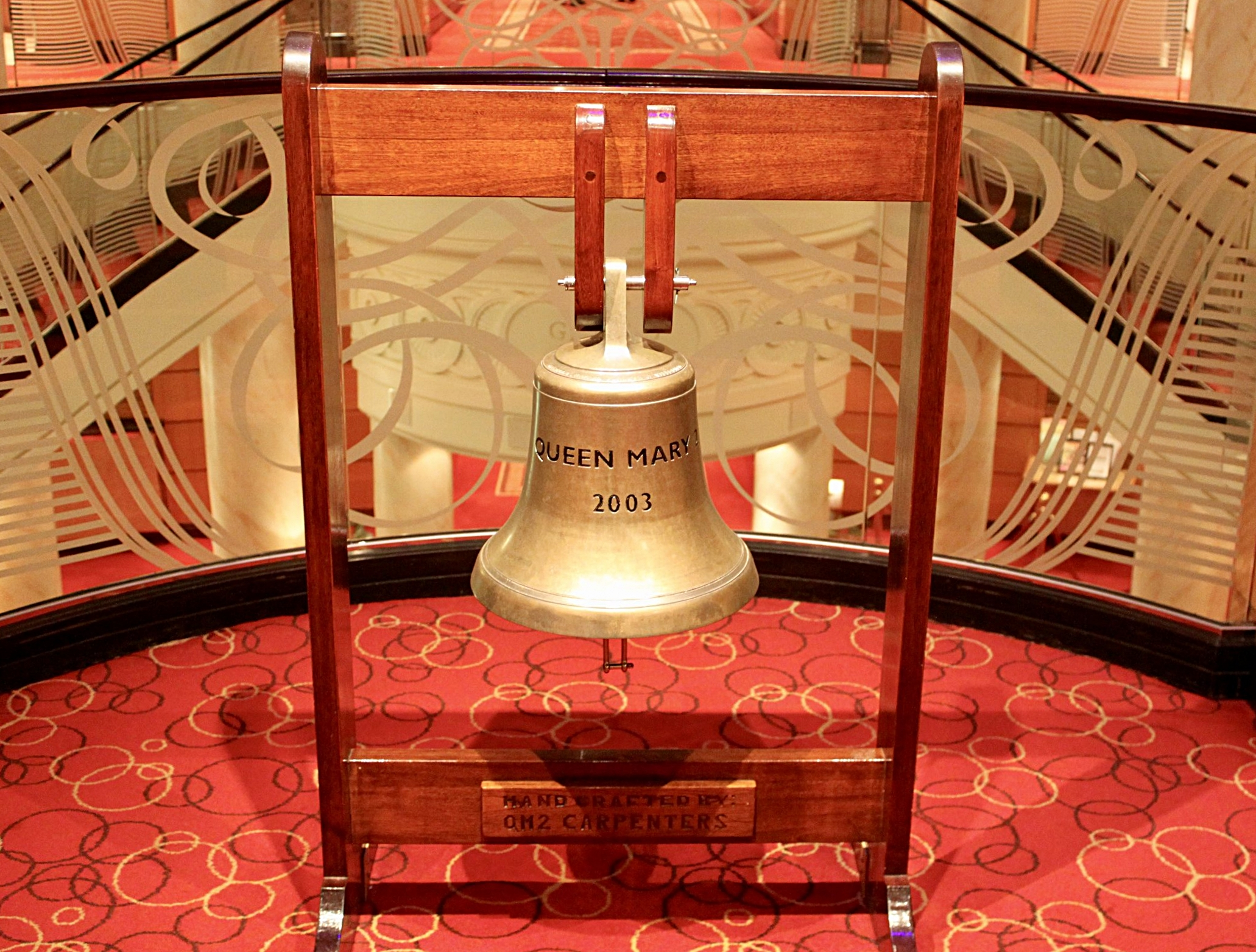 The infamous Queen Mary bell situated in the Grand Lobby of the Queen Mary 2.