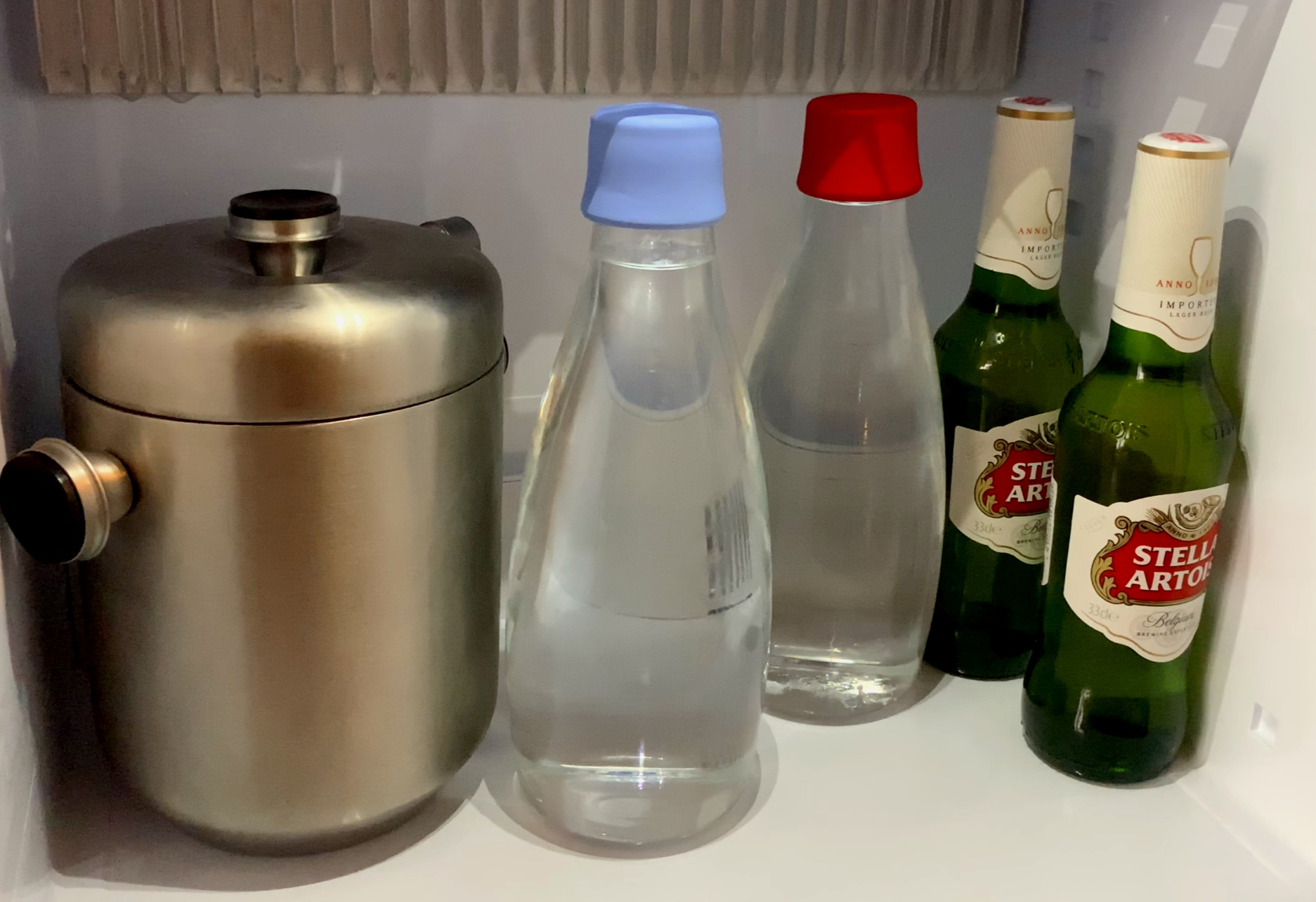 Re-fillable glass water bottles.