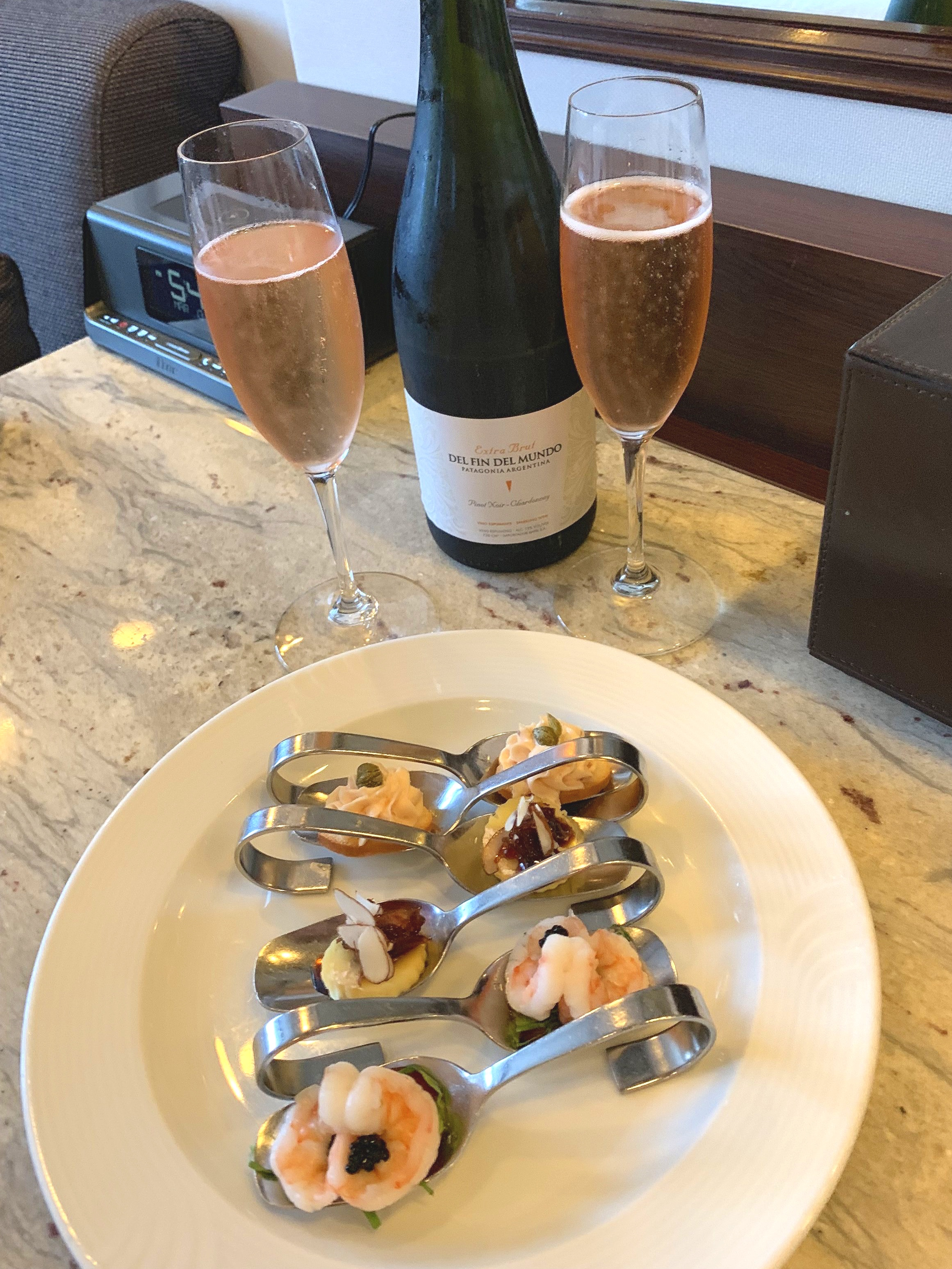 Champagne and canapés were waiting for us in our suite upon our return.