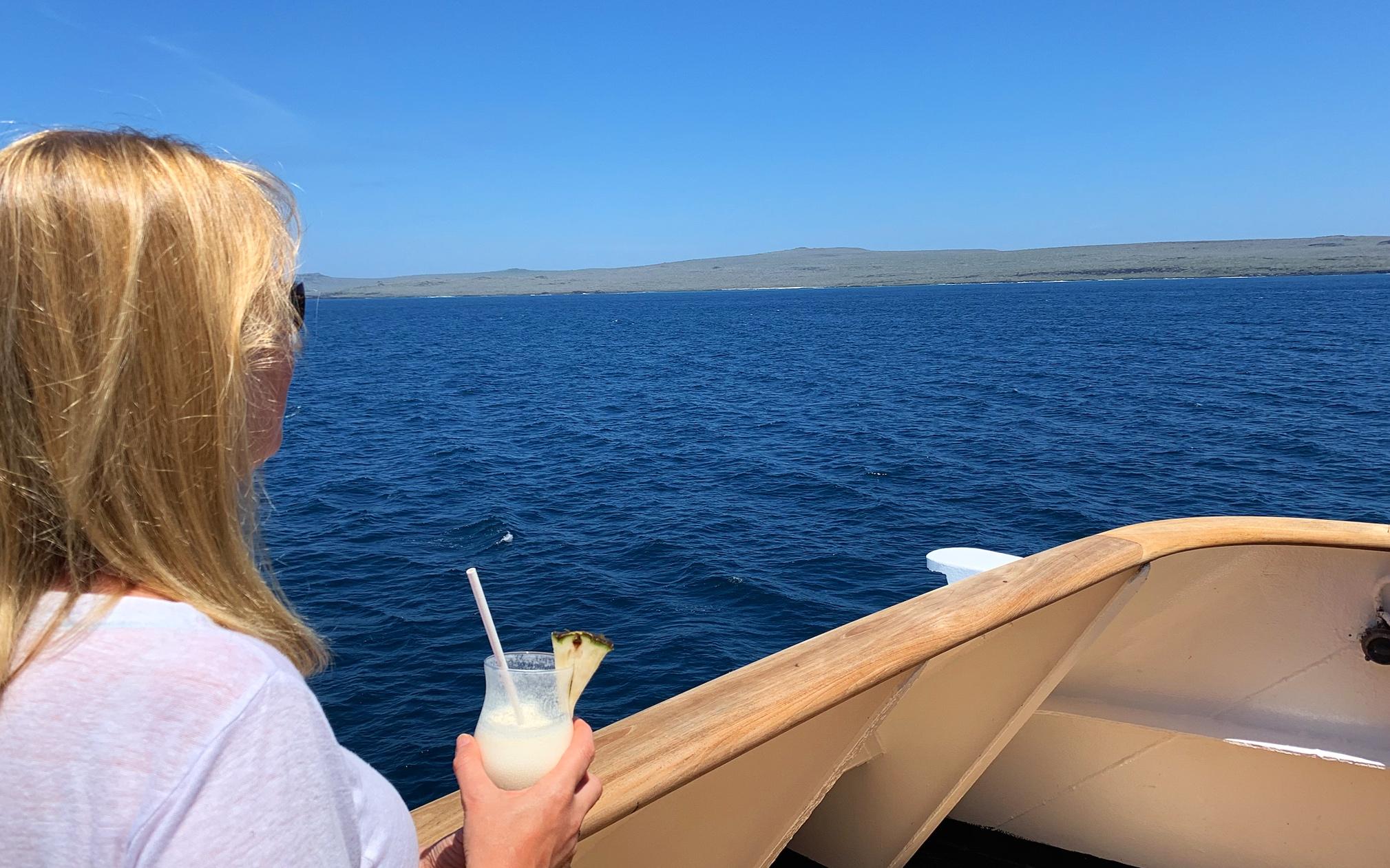 Enjoying a cocktail during sailaway.