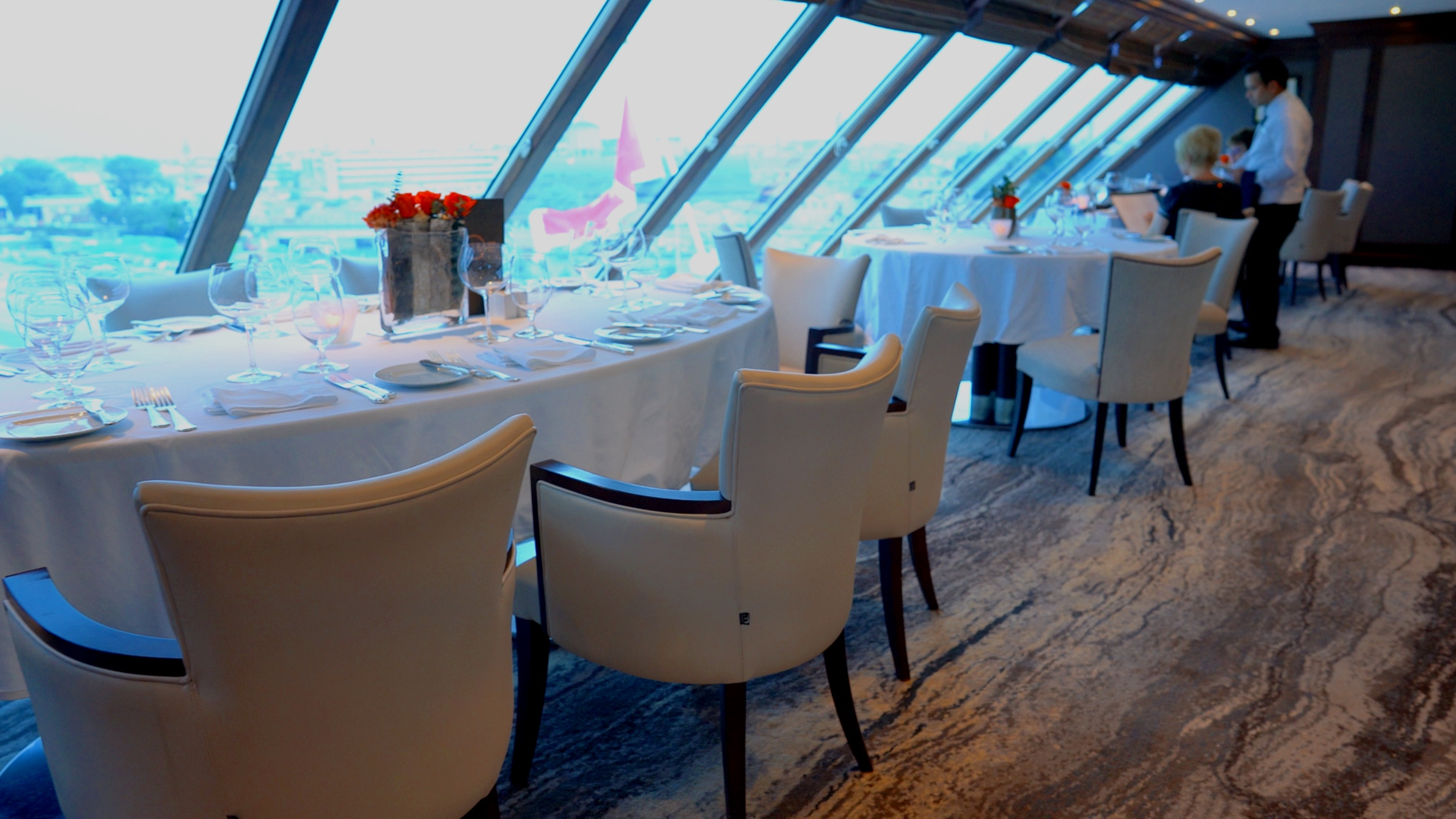 Prime C tables tucked into the bow windows.
