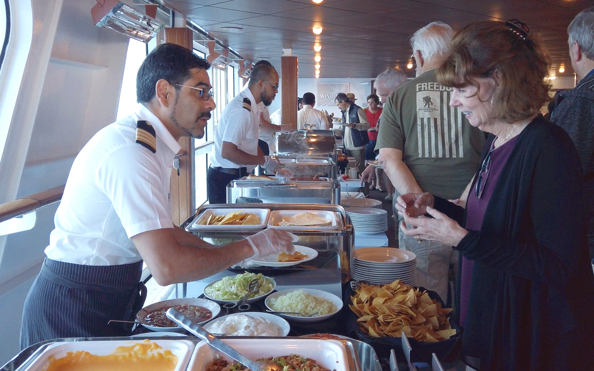 The Officers serving us our barbecue accompaniments.
