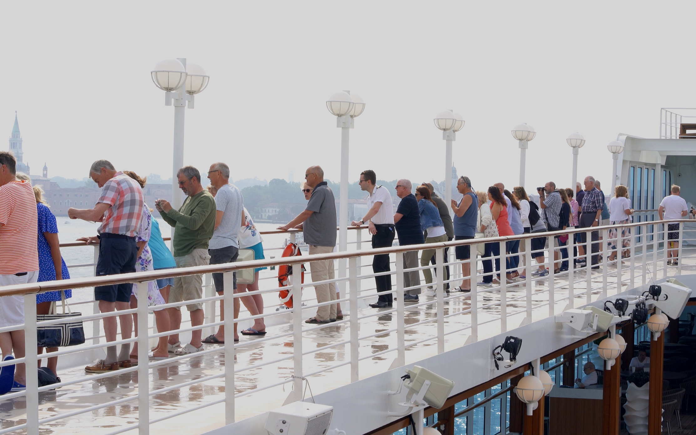 Guests on the open decks for sail into Venice.