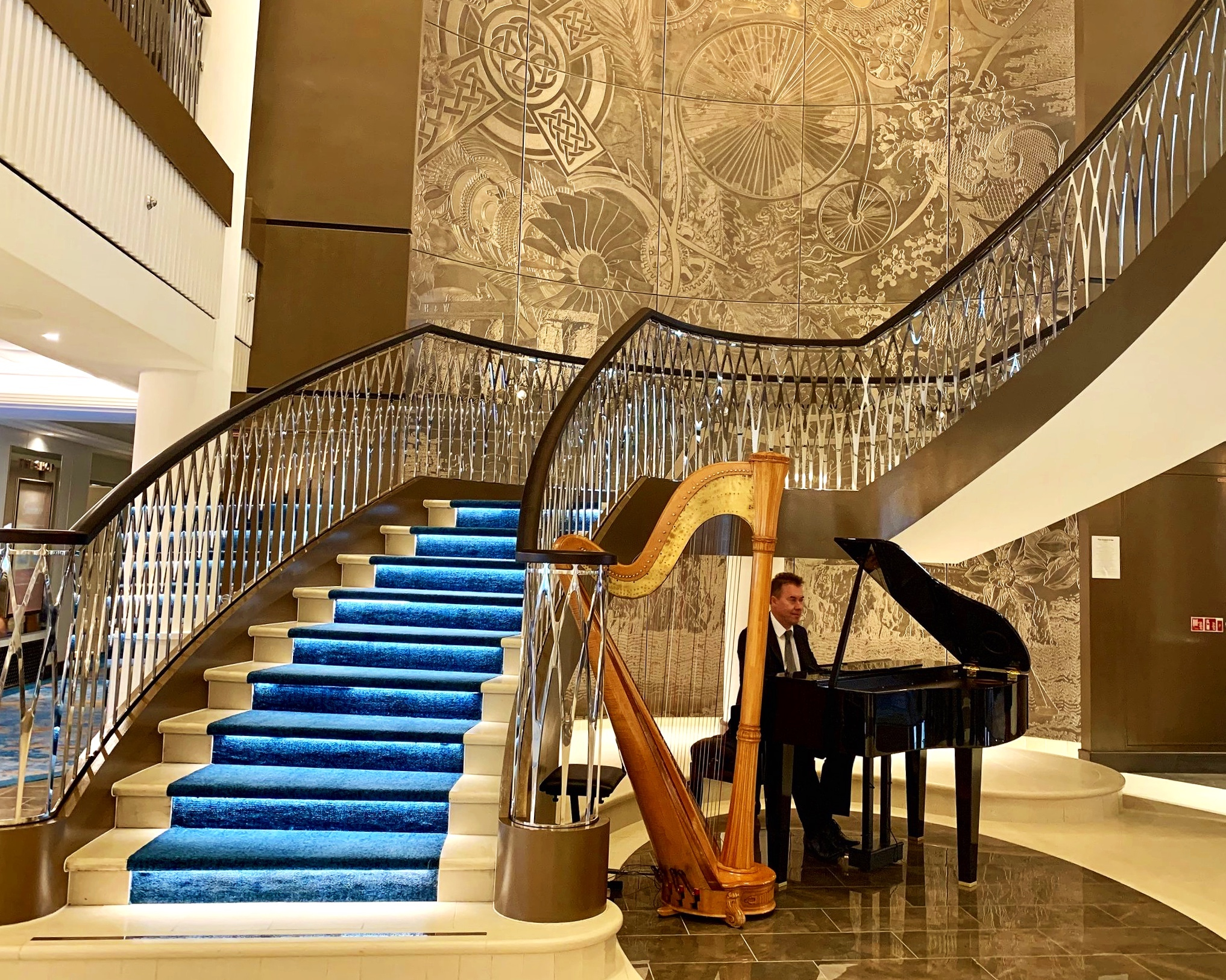 The elegant sweeping staircase