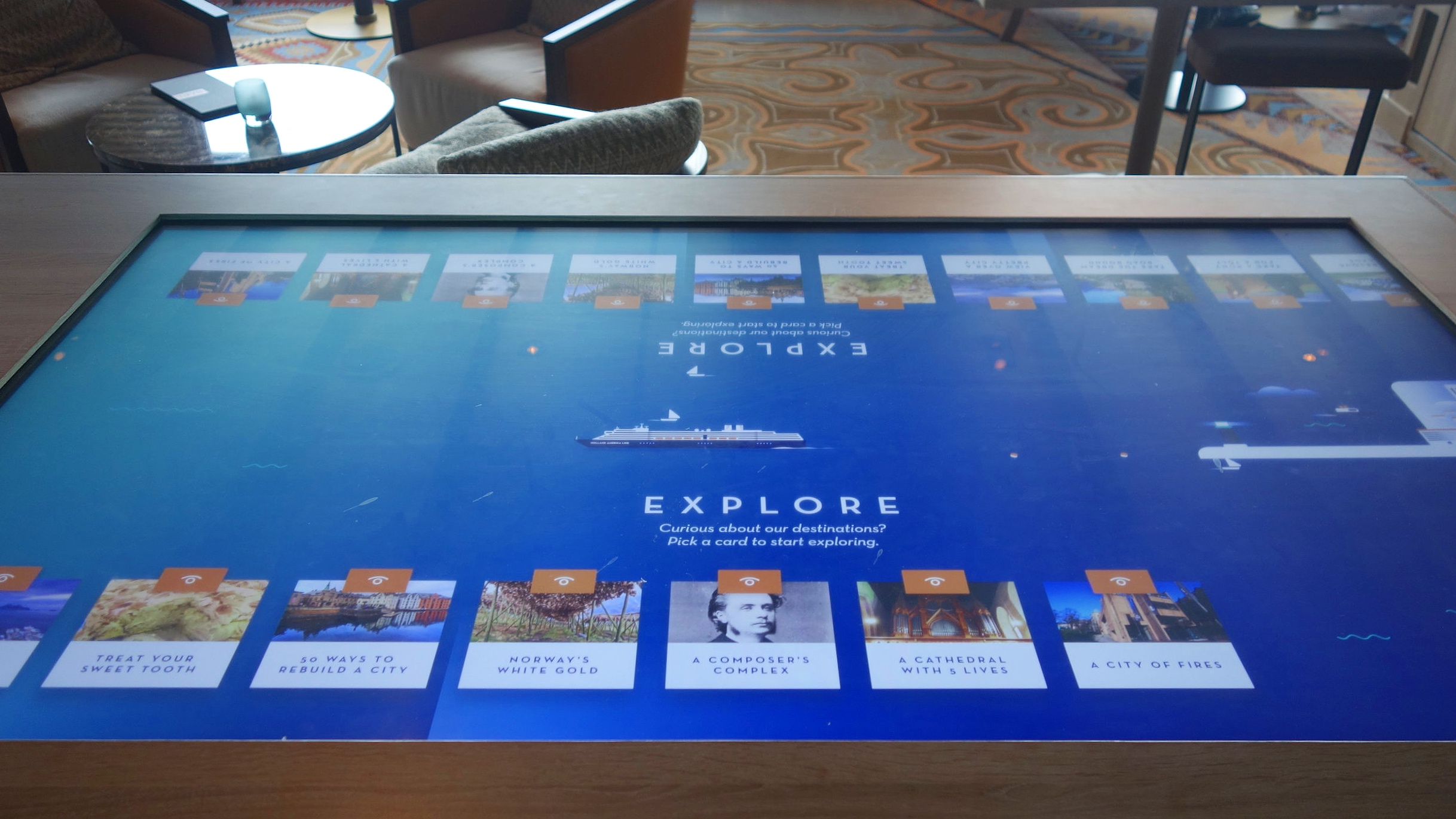 The interactive touch screens in the shore excursion area of the Explorers Lounge.