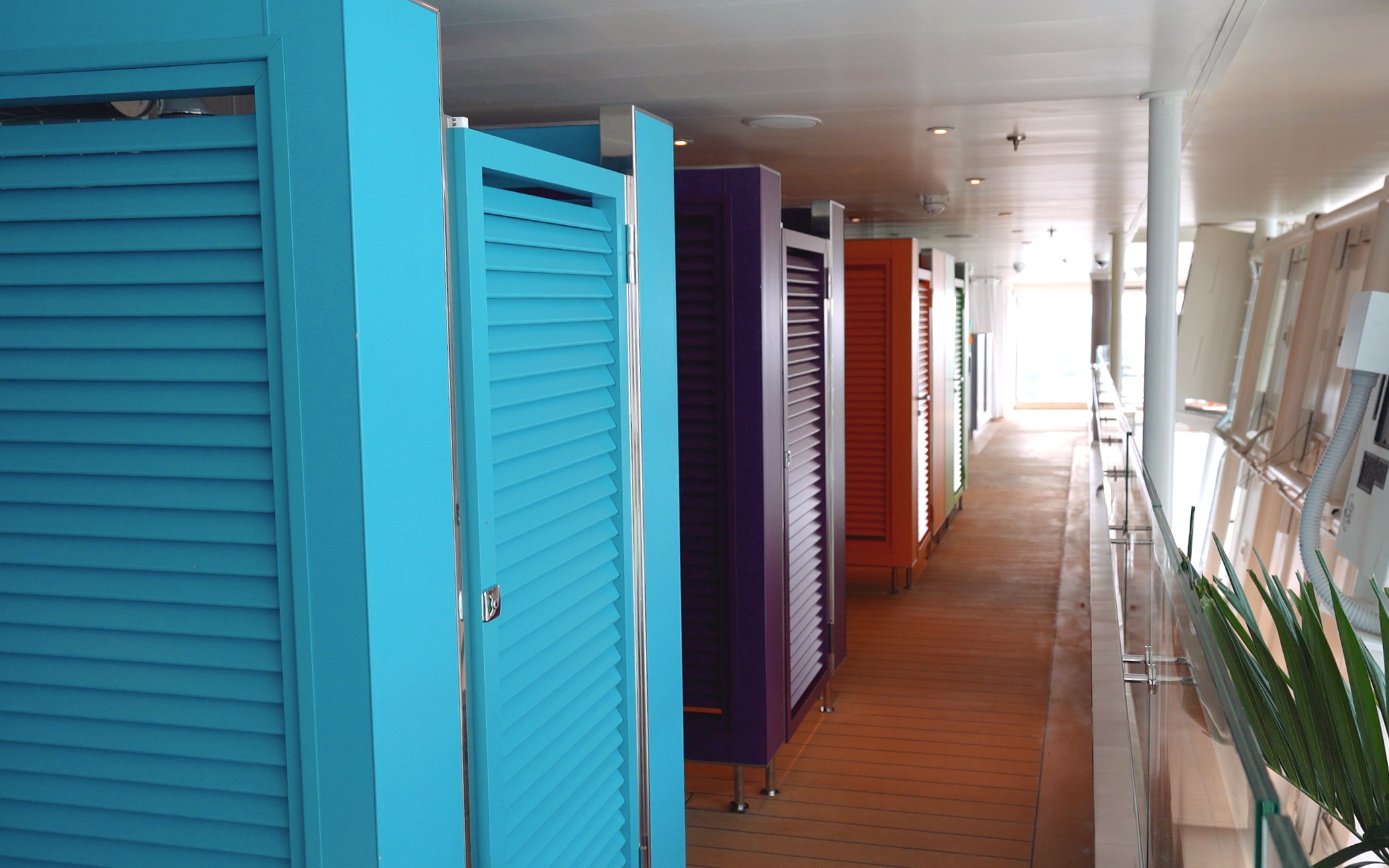 At one end of the pool we found these lovely individually coloured changing cubicles, complete with shower in each.