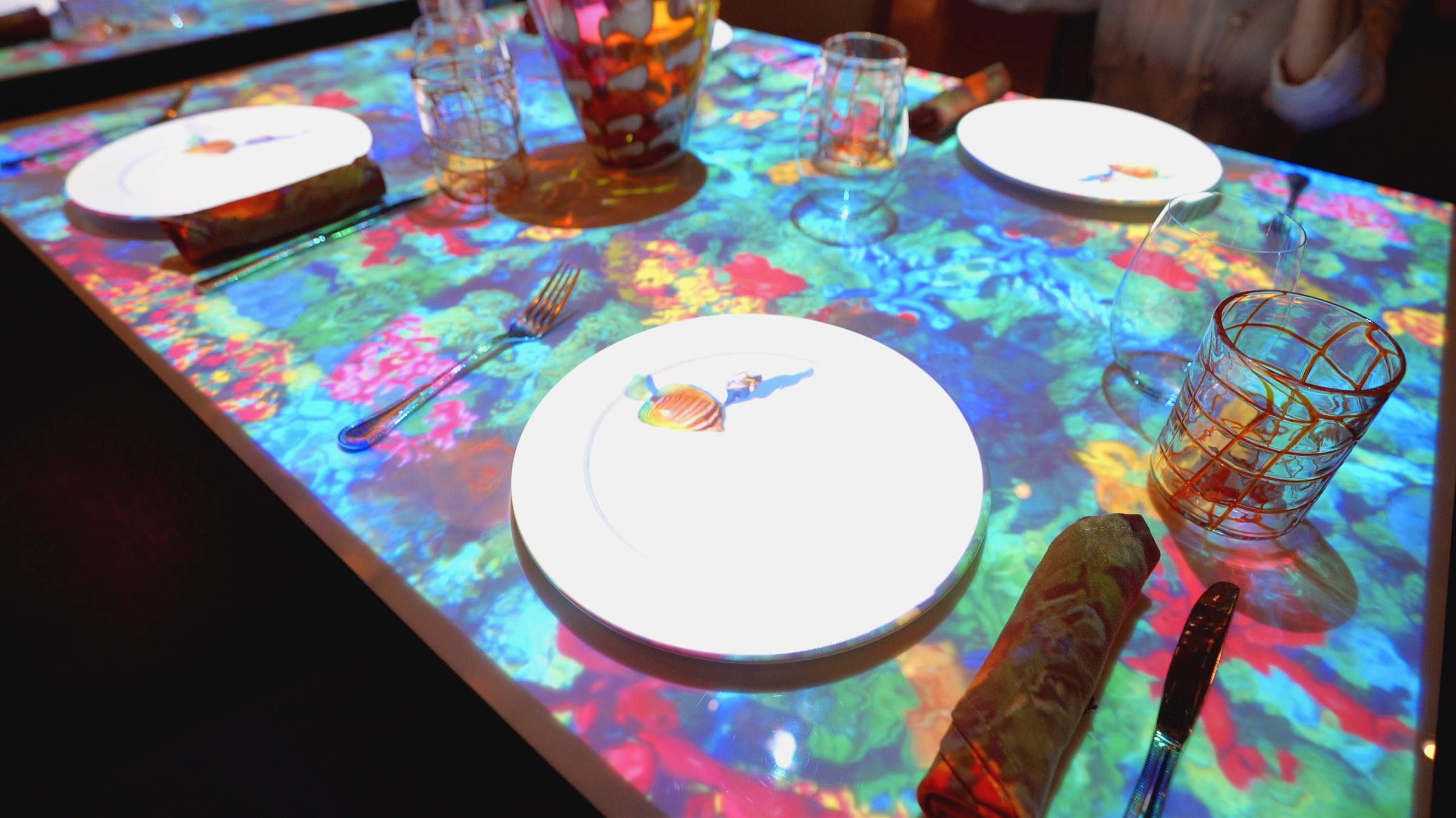 Each dish is preceded by a projection show.