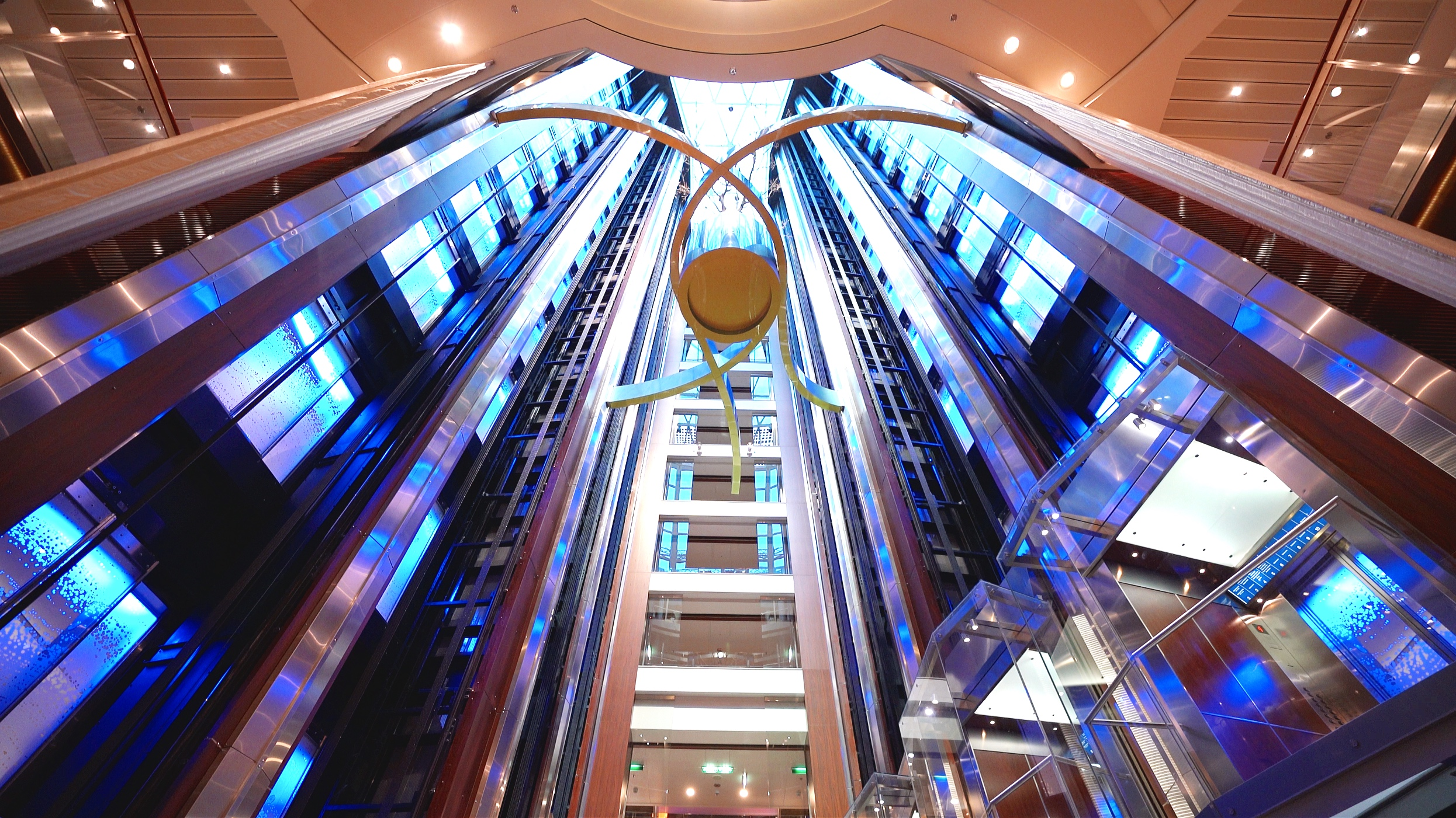 The glass lifts traverse the entire height of the atrium