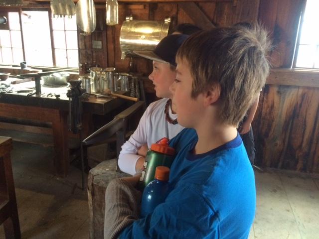 CTES 6th graders observing the Tin Smith at Sturbridge Village.