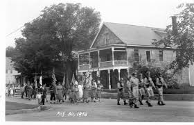 Memorial Day Parade in Cavendish May 30, 1955. This picture was taken in front of the current Black River Health Center Building. The porches have been removed.