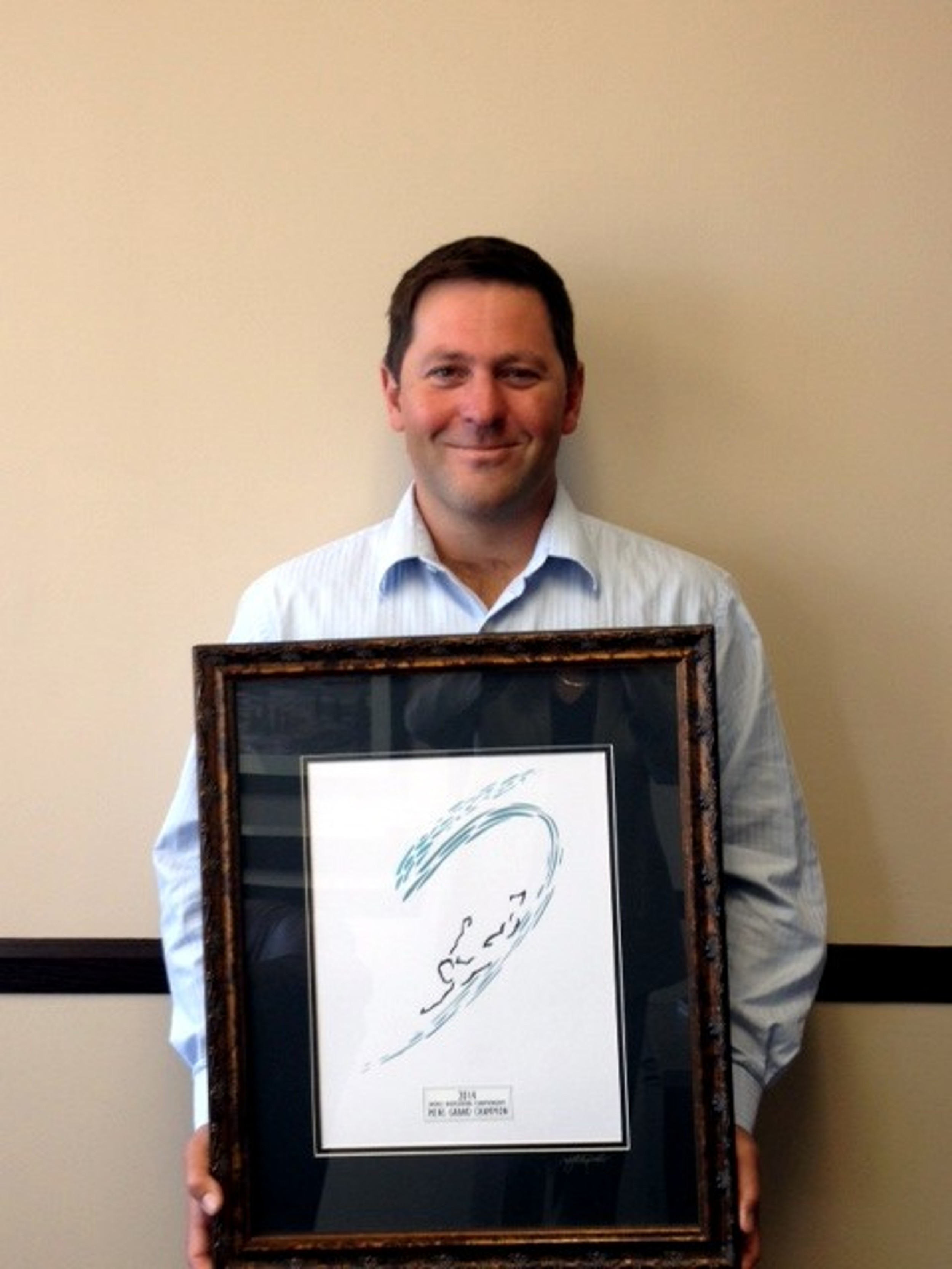 Brett Templeman holds his bodysurfing award.