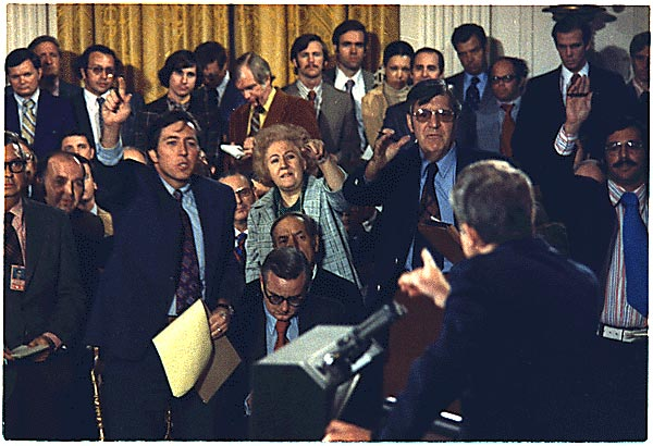 Journalists question President Richard M. Nixon during a Watergate press conference—Oct. 26, 1973.  White House Photo Office Collection.