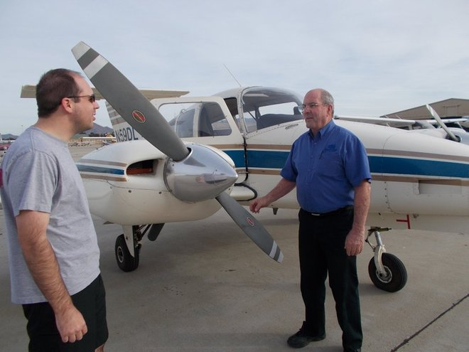 Channel Islands Aviation Flight School chief flight instructor David Koble (right) conducts a flight lesson with Danny Zarachoff, of Moorpark. The school has received examination approval from the Federal Aviation Administration.