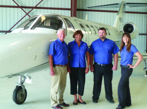 From left, Mark Oberman, Janie Oberman, Mike Oberman and Sarah Oberman Bartush pose in front of one their jets.