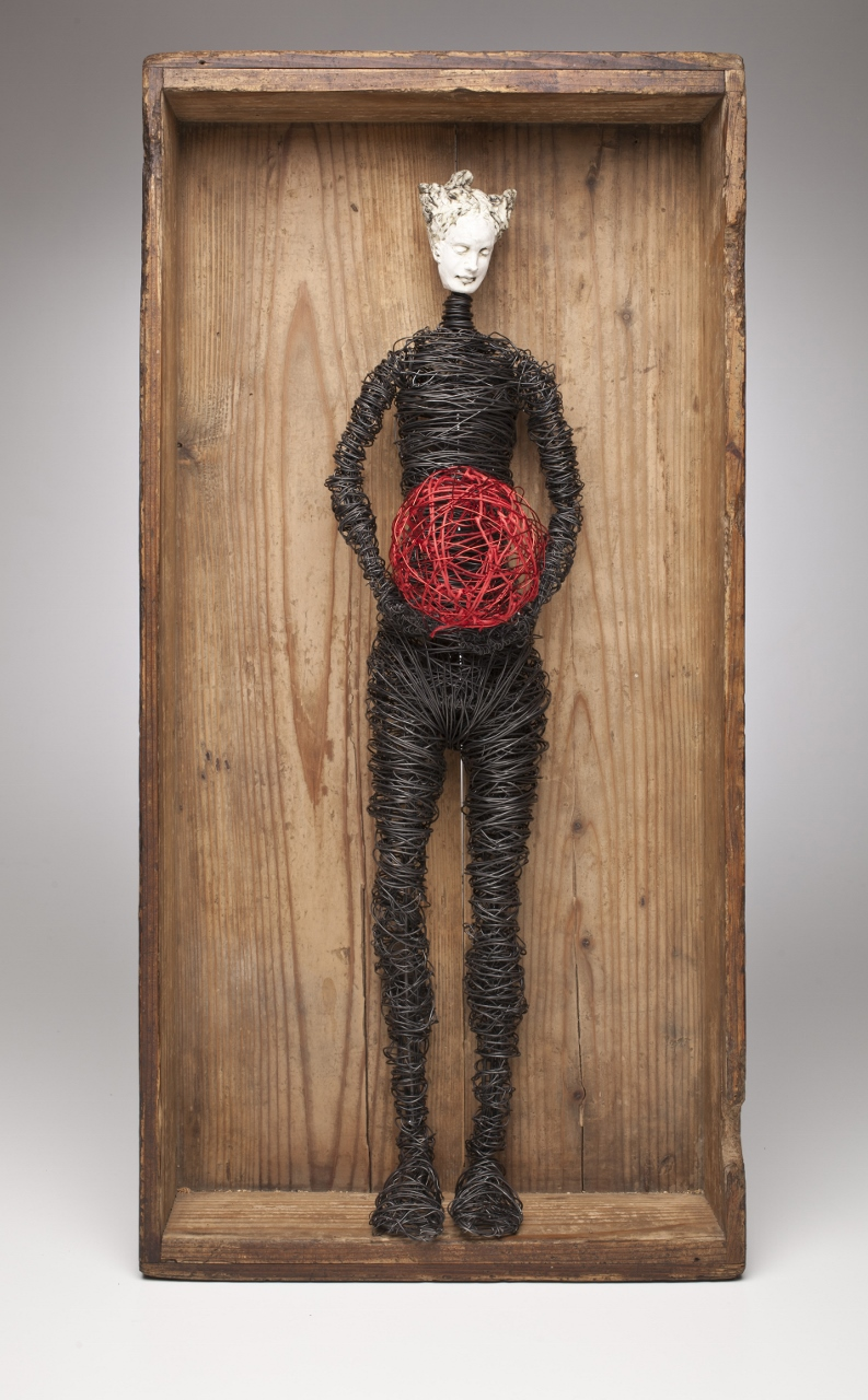 Figure in Box with Red Ball